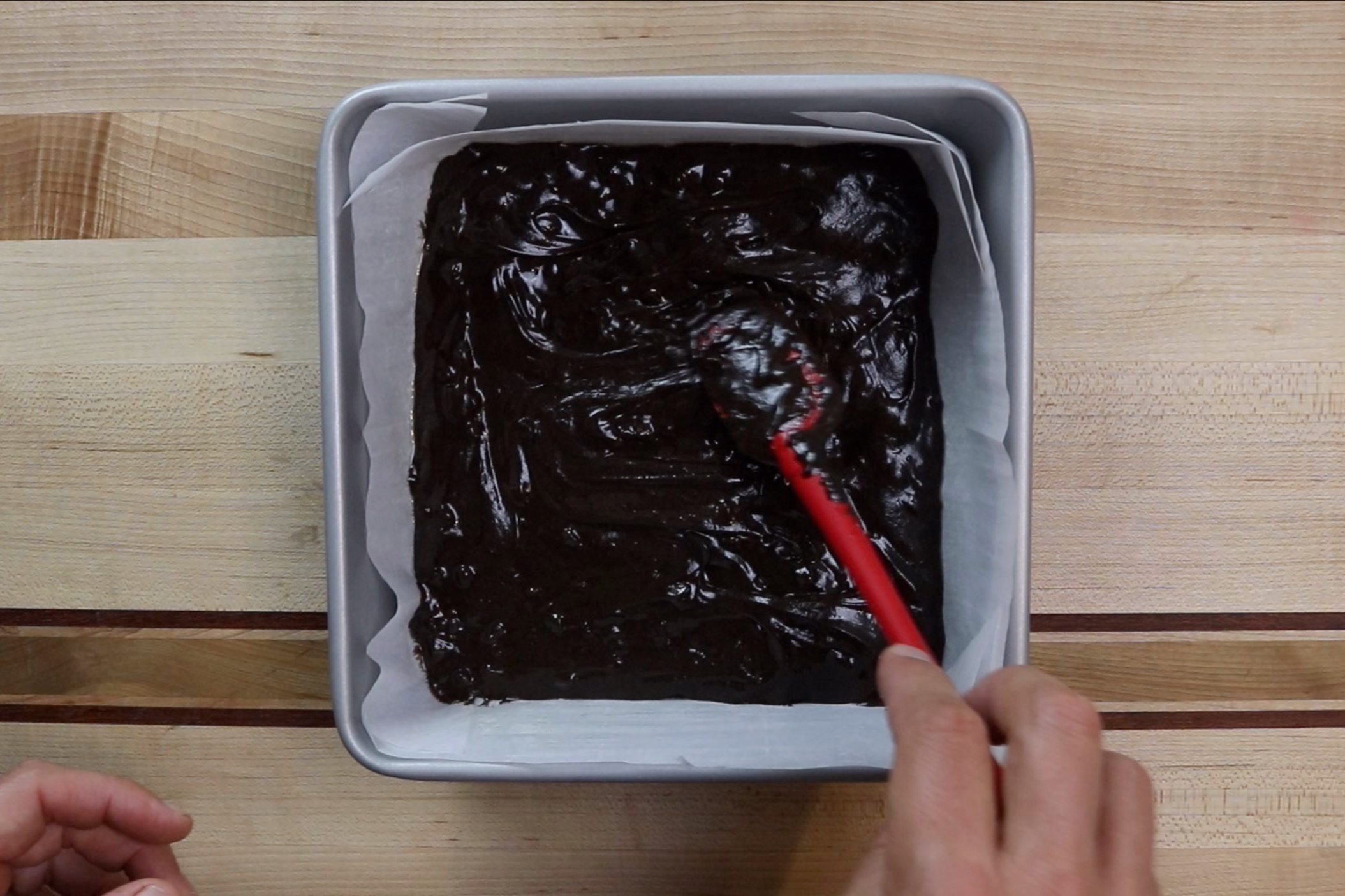 7. Pour the batter into the pan and spread evenly. -