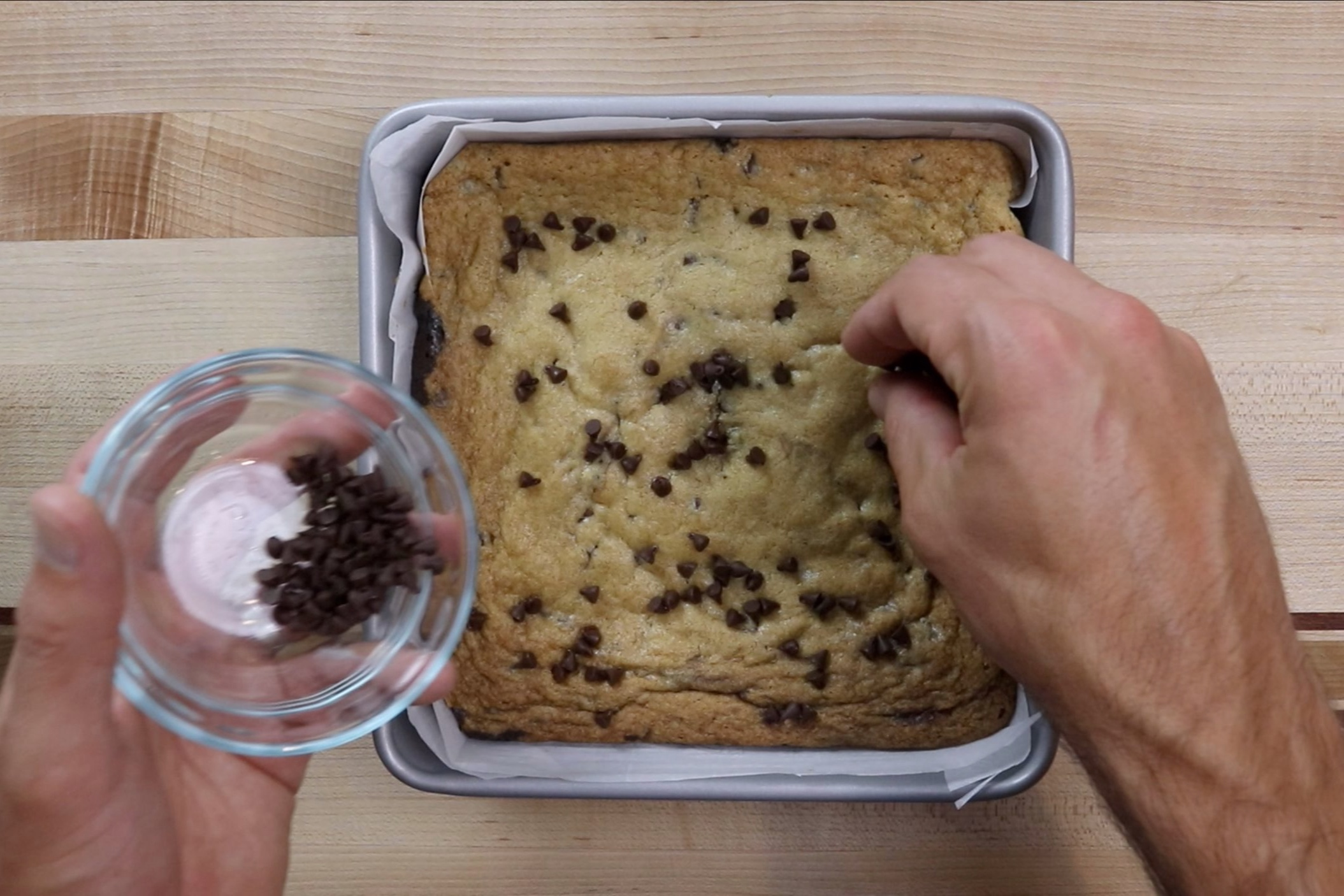 15. Remove from oven and sprinkle a few chocolate chips on top of the baked brookies. -
