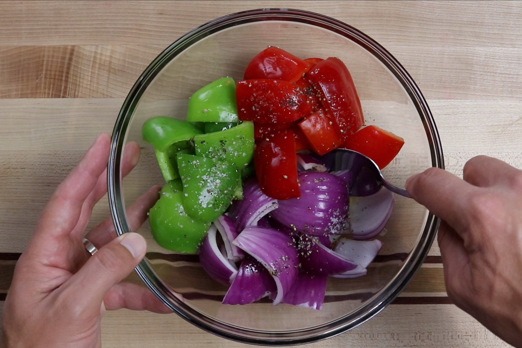7. Add the olive oil, salt and pepper to the veggies and stir until all pieces are coated. Set aside. -