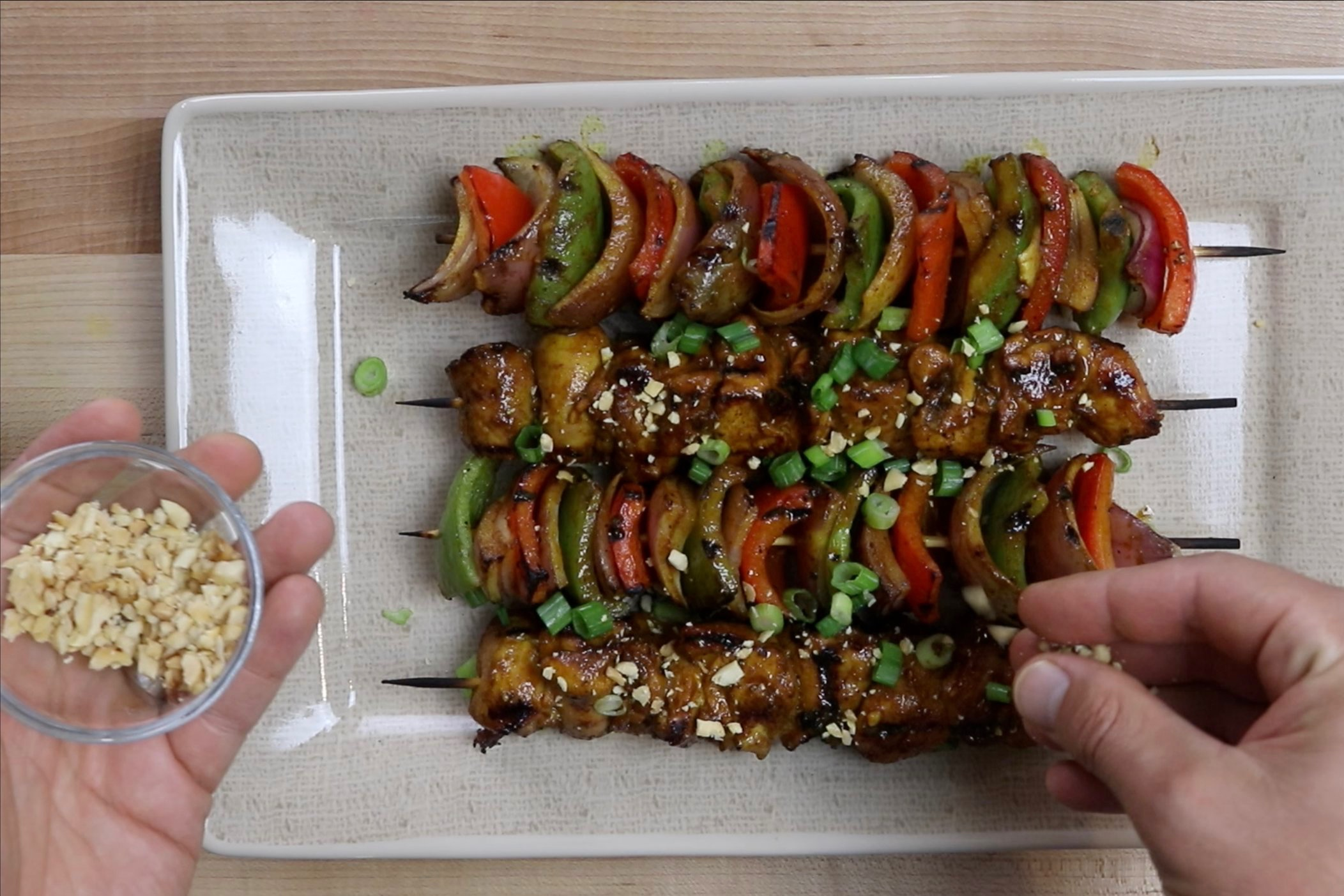 12.  Sprinkle with green onion and peanuts if desired. -