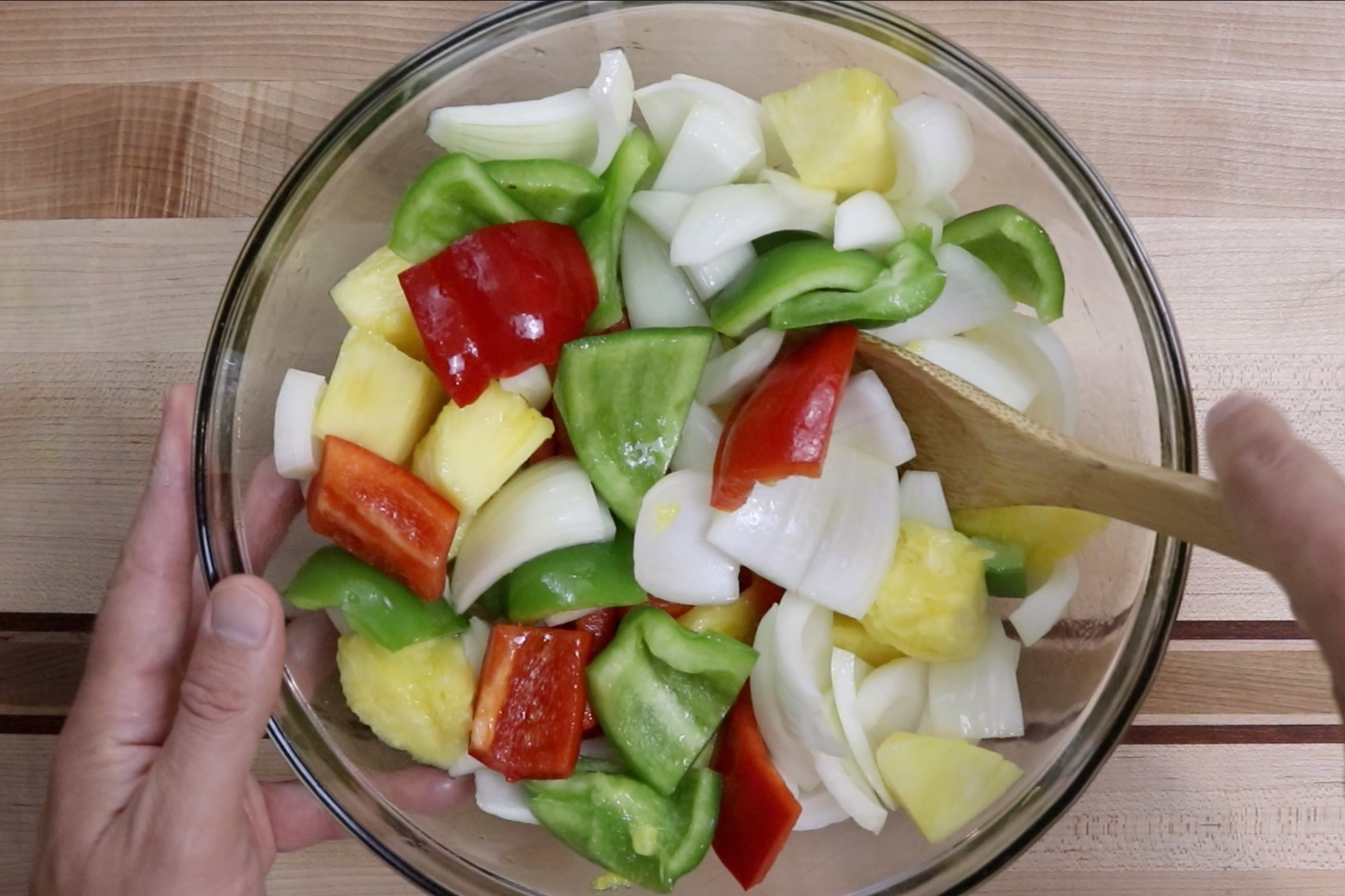 4. In a large bowl add the onions, peppers and pineapple. Stir in the olive oil making sure all pieces are coated. Set aside. -