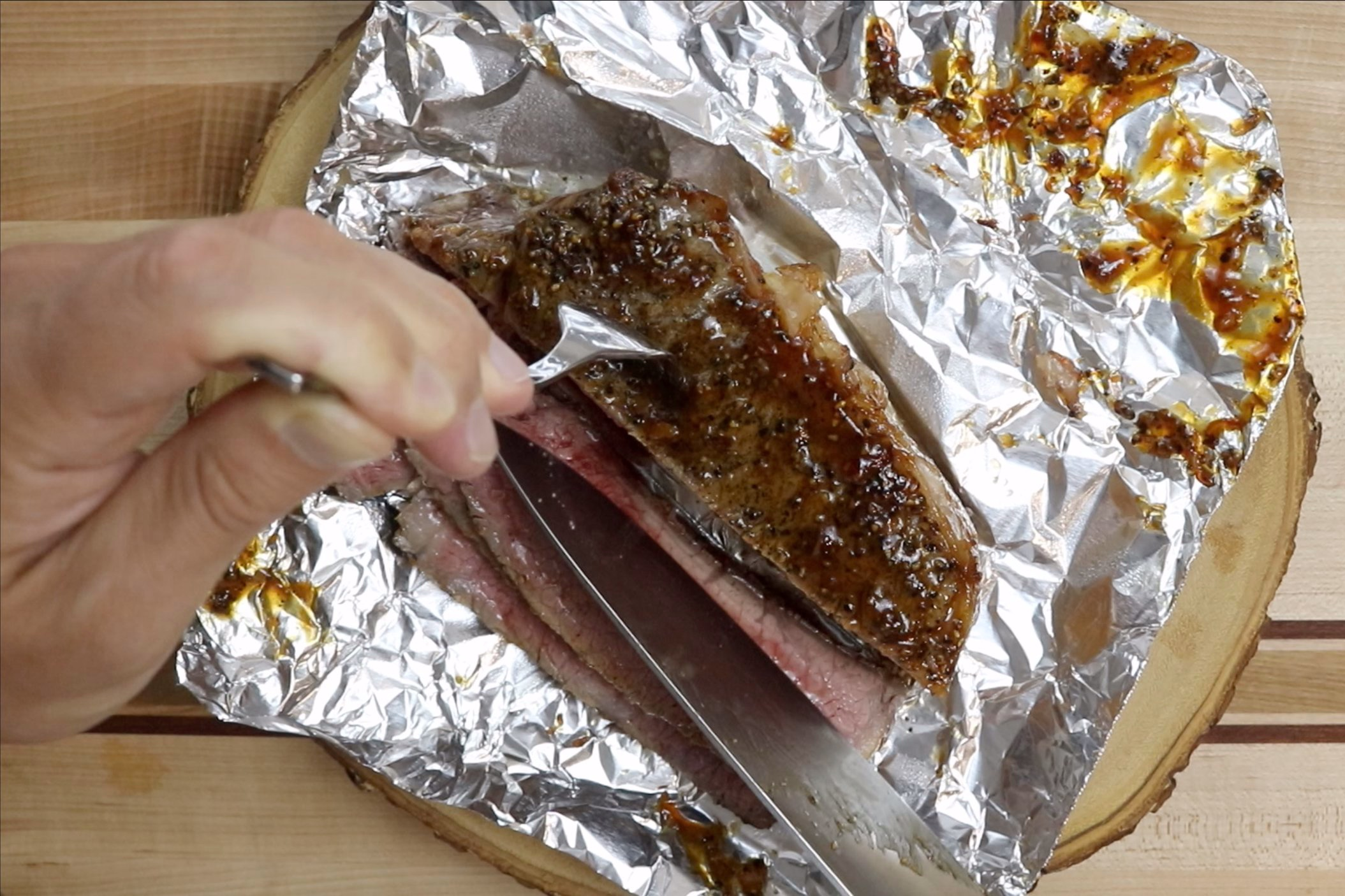 13. Remove veggies from oven and slice steak against the grain into thin strips. Serve with coconut rice if desired. -