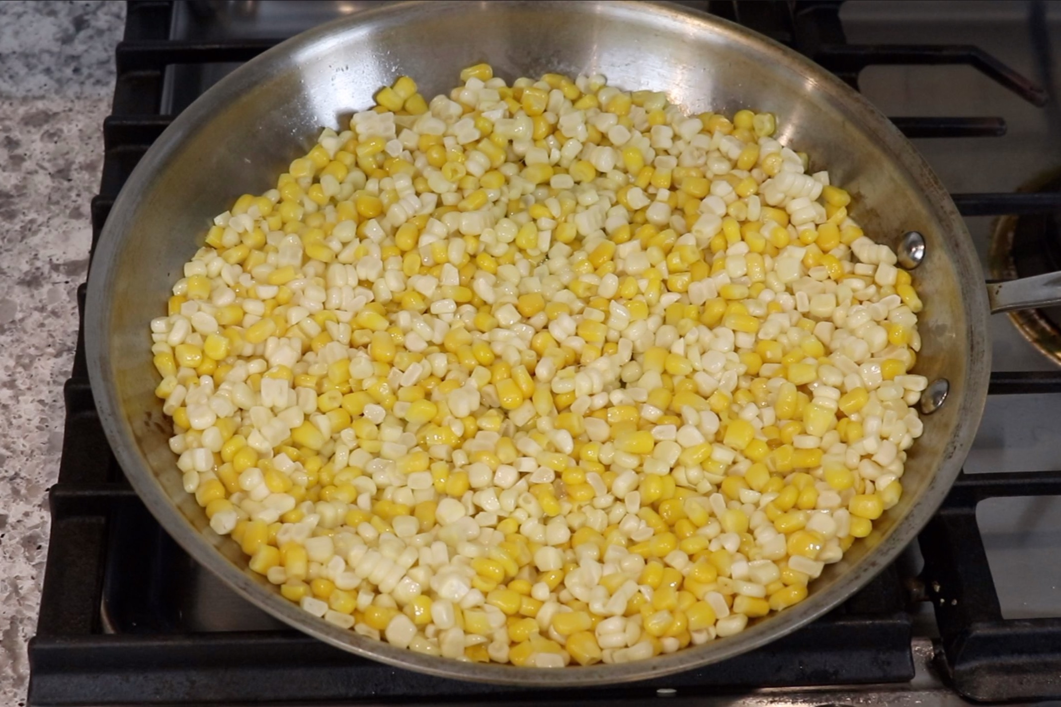 2. Add olive oil and corn to a large skillet and heat over medium-high for 10 minutes. -
