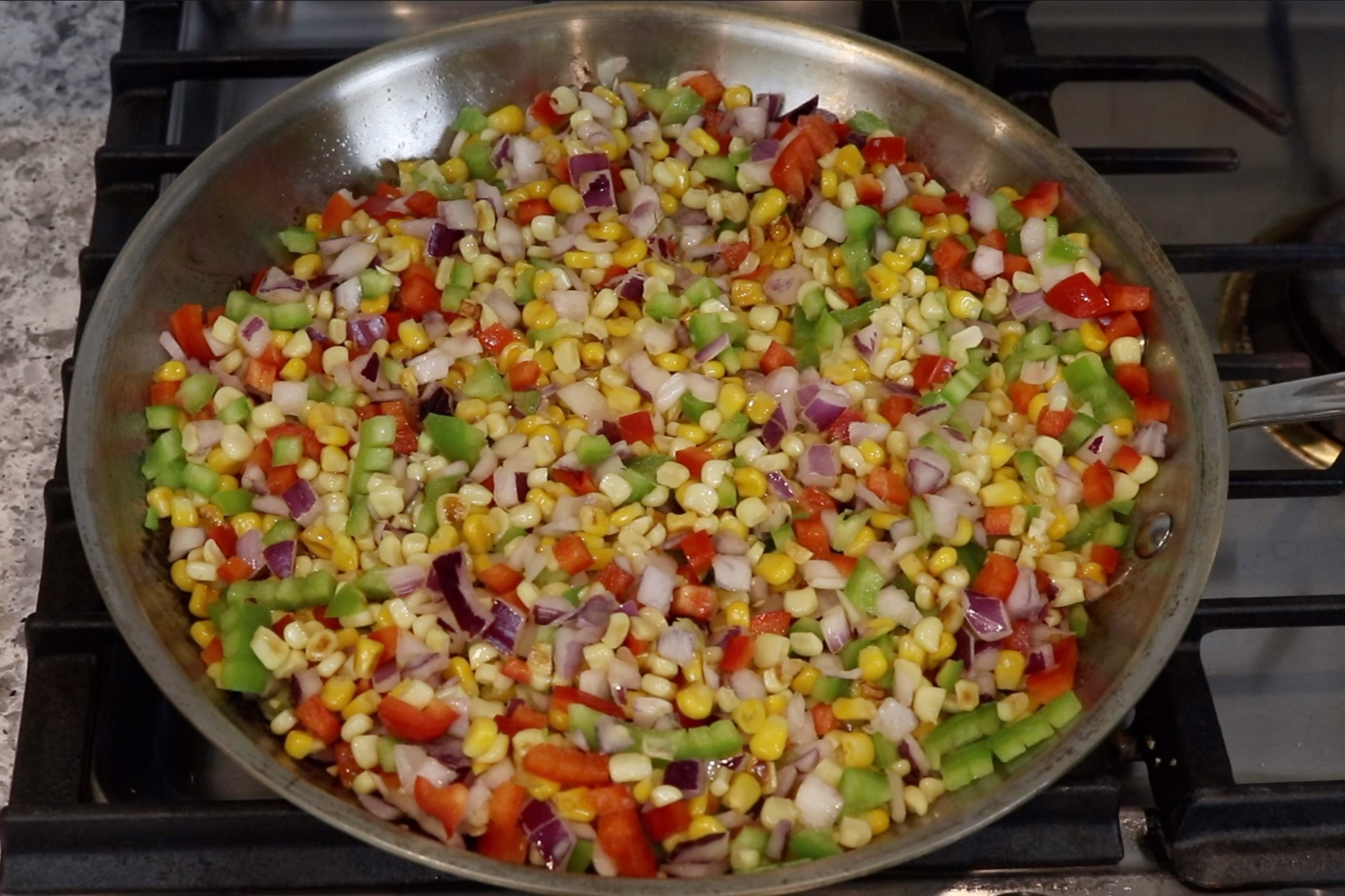 3. Add the garlic, onion and bell peppers to the skillet. -