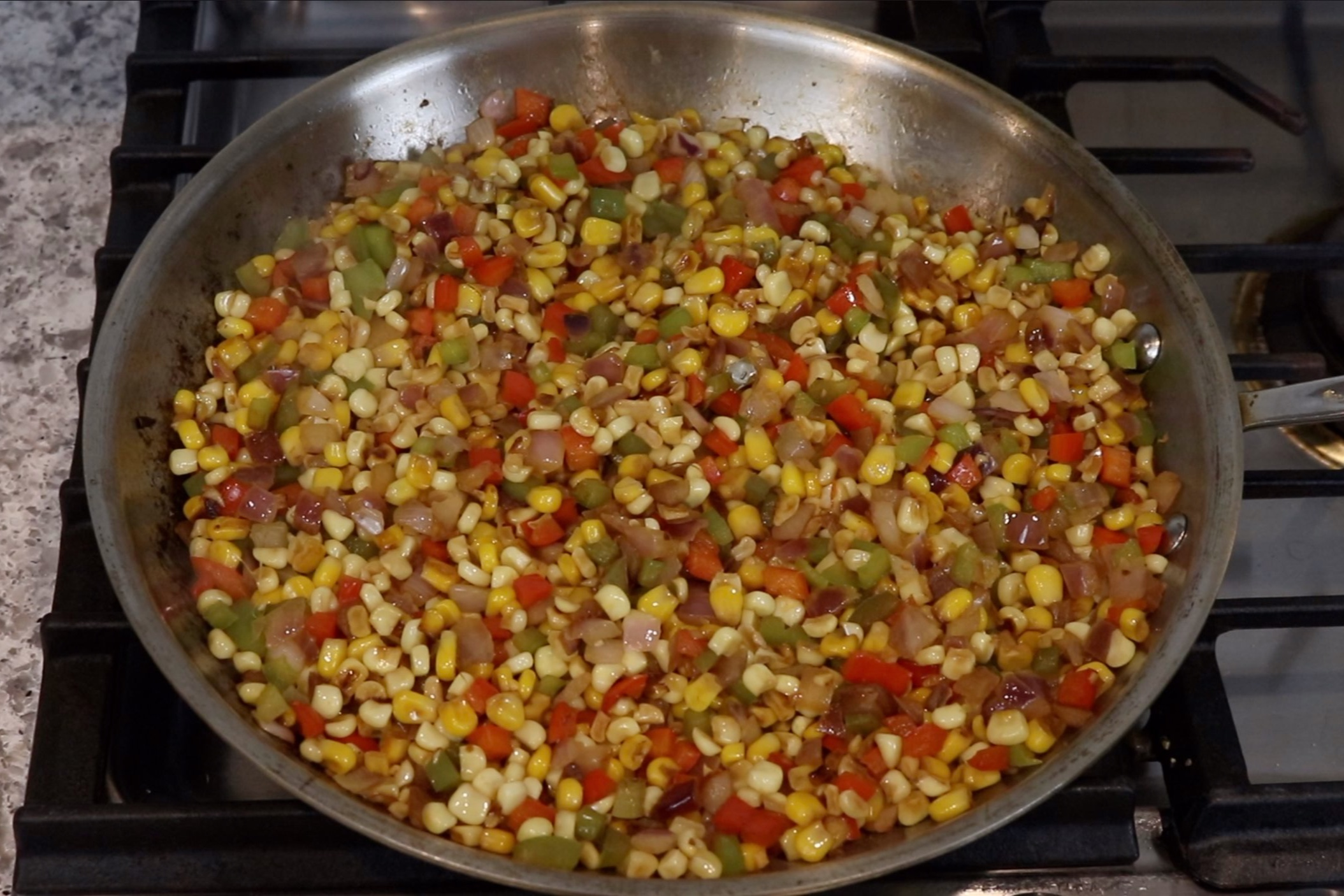 4. Cook for another 5-10 minutes until the corn starts to char. Remove from heat and cool to room temperature. -