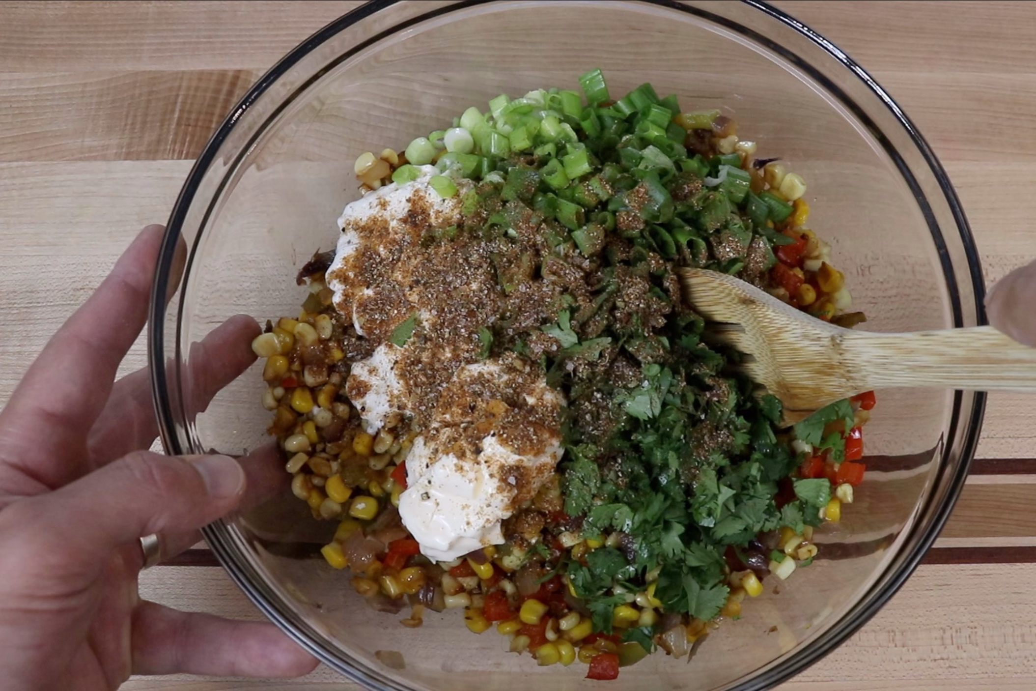 5. In a large bowl, combine the corn mixture, sour cream, mayo, green onions, cilantro, lime juice and southwest seasoning. Stir together until combined. -