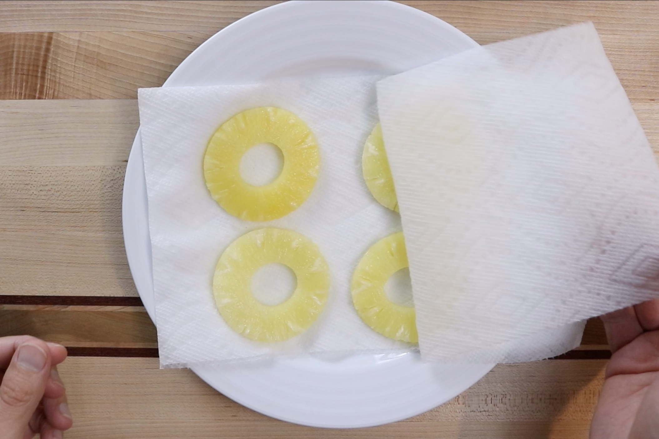 2. Take pineapple out of can and dry between two paper towels. -