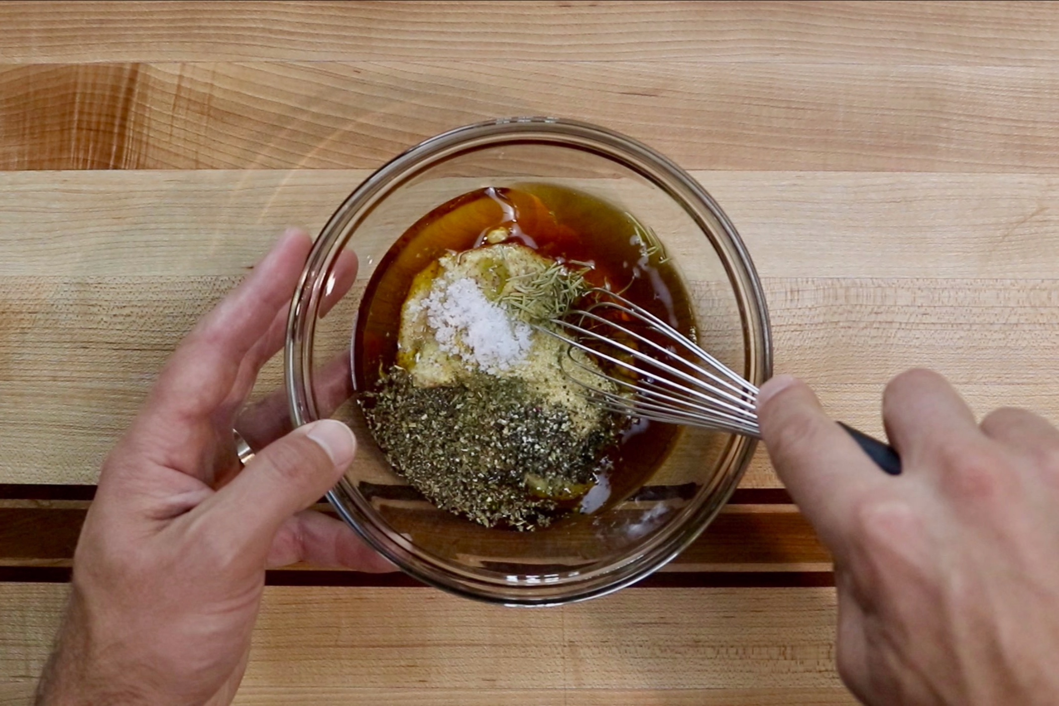 1. Make the marinade. In a small bowl, add the maple syrup, mustard, olive oil, garlic powder, onion powder, basil, rosemary, salt and pepper. Whisk together until combined. Set aside 1/2 cup of the marinade cover and refrigerate. -