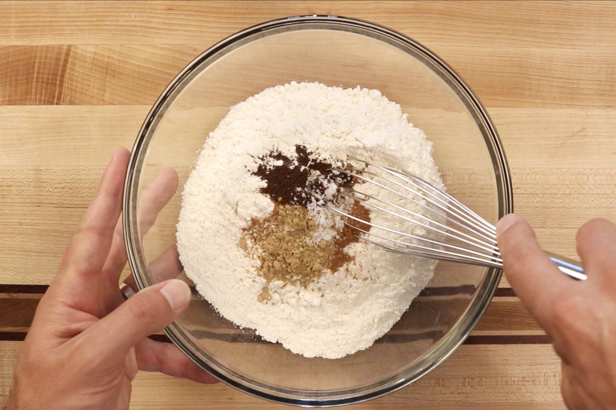 1. In a medium bowl, whisk together flour, baking soda, cinnamon, ginger, clove and salt. Set aside. -
