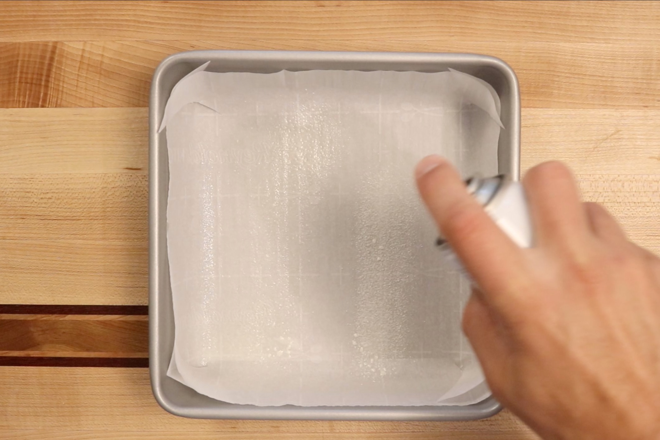 1. Preheat oven to 325 degrees. Line an 9 x 9 baking pan with parchment paper or grease with baking spray. -