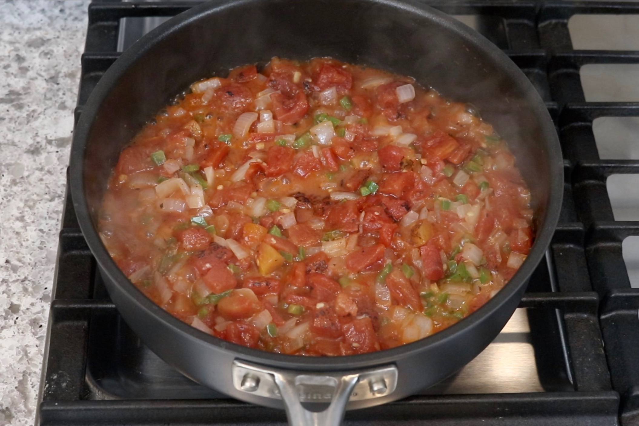 3. Stir in the tomatoes and cook for 3-4 minutes. -