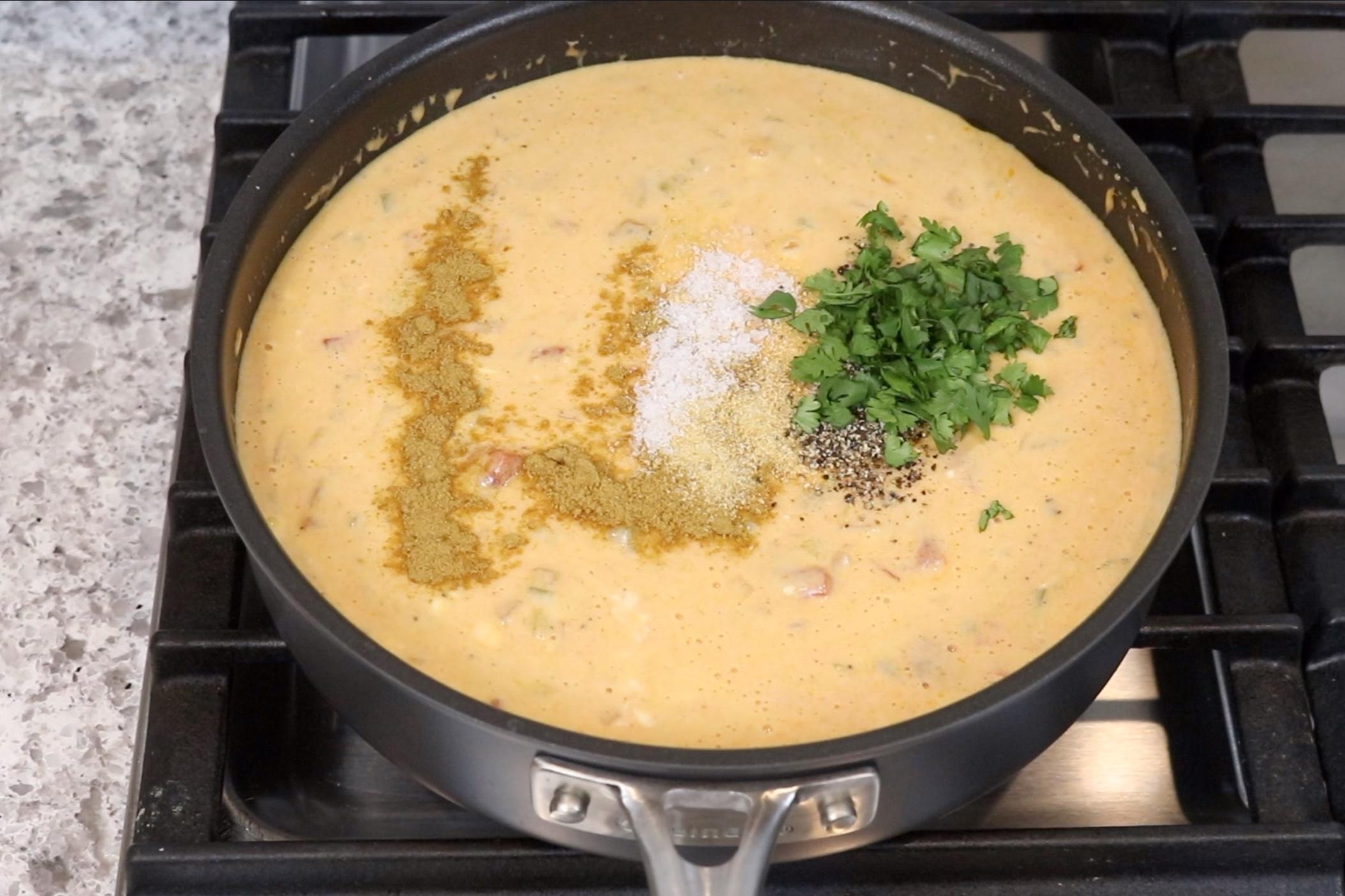 7. Add the cumin, onion powder, salt, pepper and cilantro. Stir to combine. -