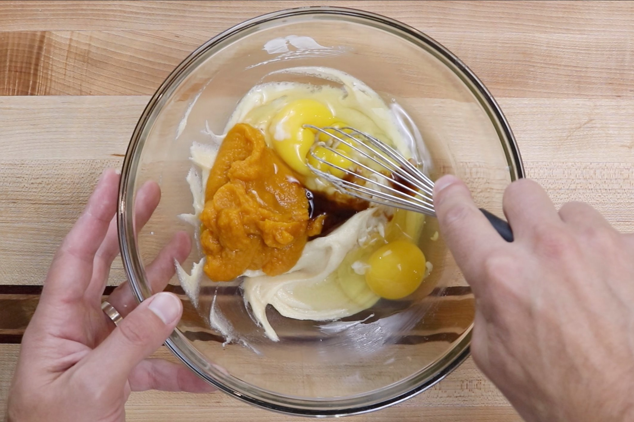 4. Add the pumpkin, eggs and vanilla. Whisk until incorporated. -