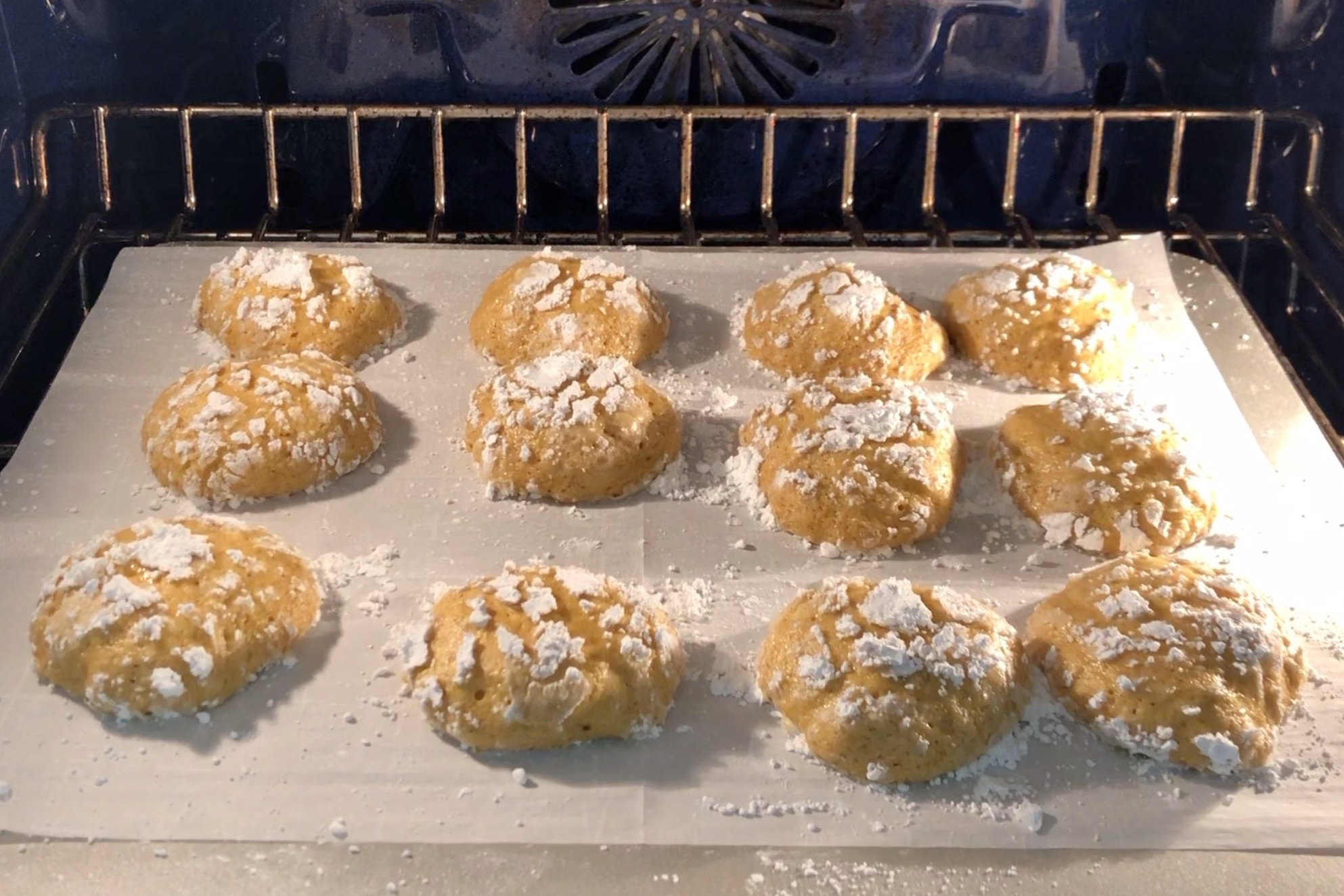 12. Bake cookies for 15 minutes. Cookies should look cracked and puffy. -