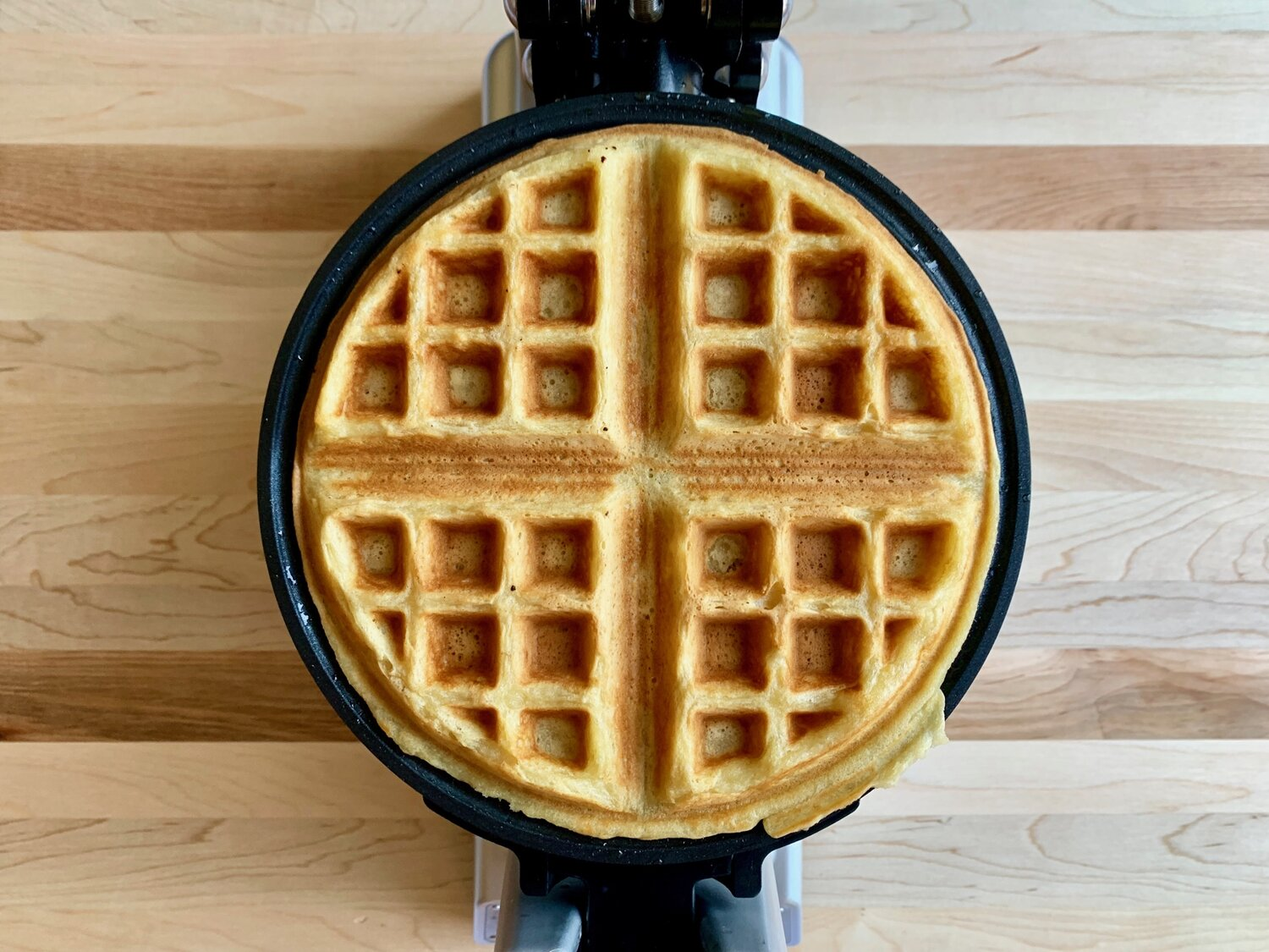 6. Cook waffles according to manufacturer's instructions, approximately 2-3 minutes. Serve with fresh berries and cream or maple syrup. -