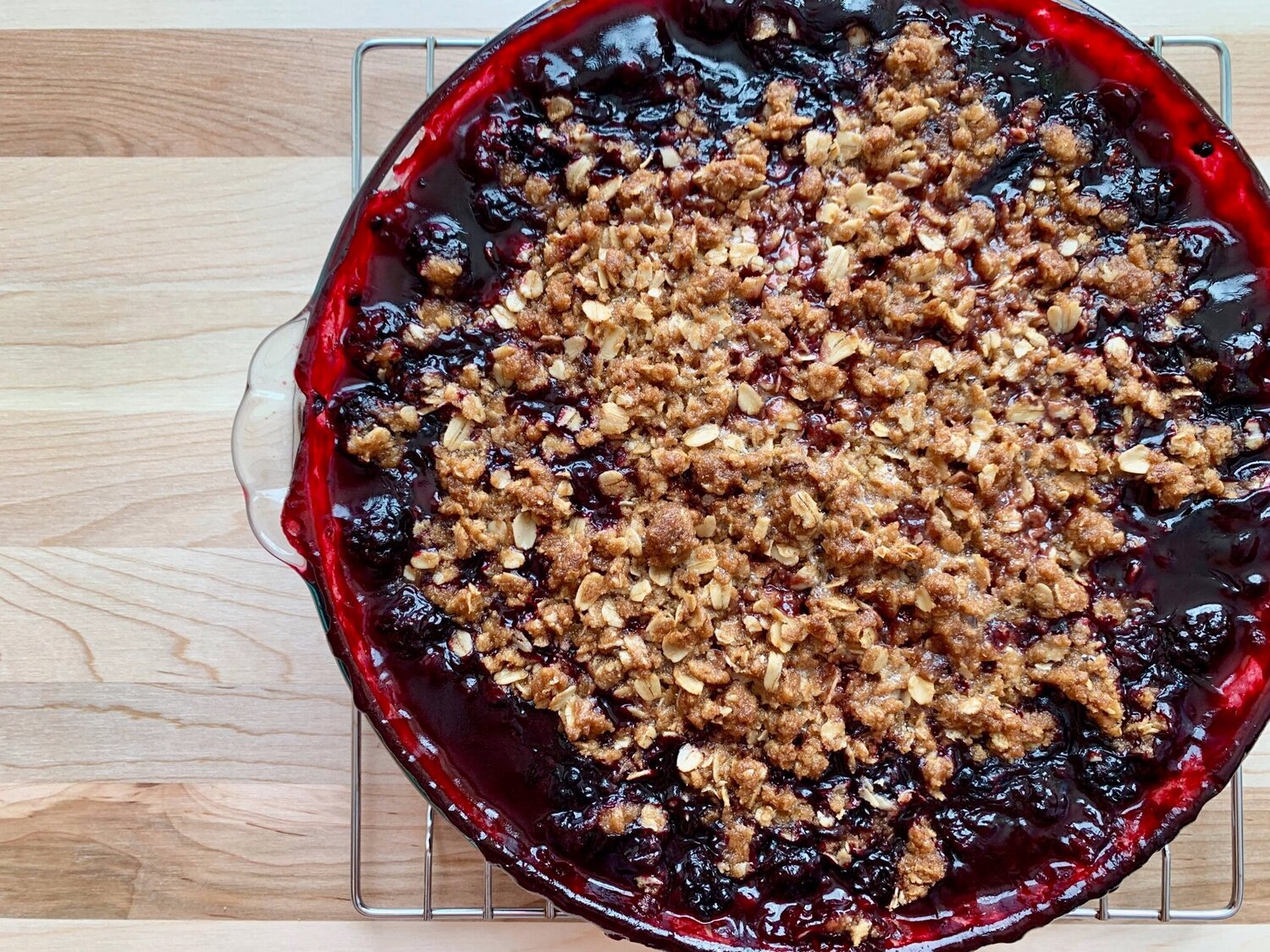 7. Bake approximately 60 minutes until the topping is browned and berry filling is bubbling. A baking sheet may be placed on the rack below to catch any drippings. -