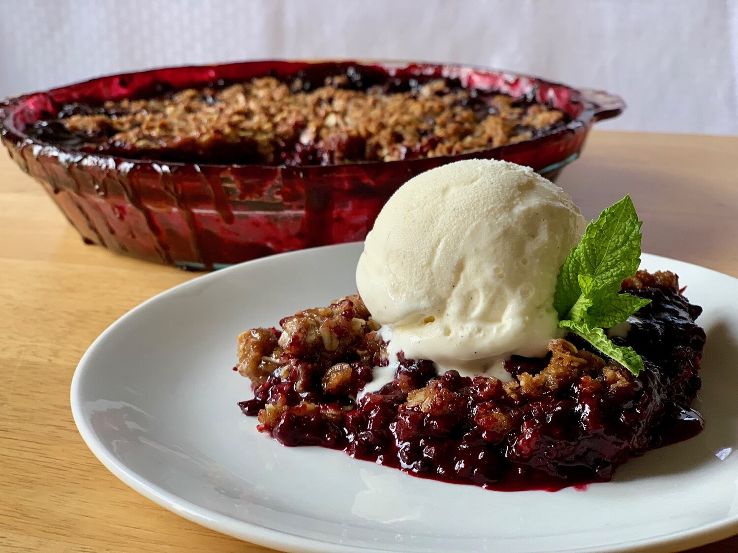 8. Serve warm or allow to cool to room temperature, topped with a scoop of vanilla bean ice cream. -
