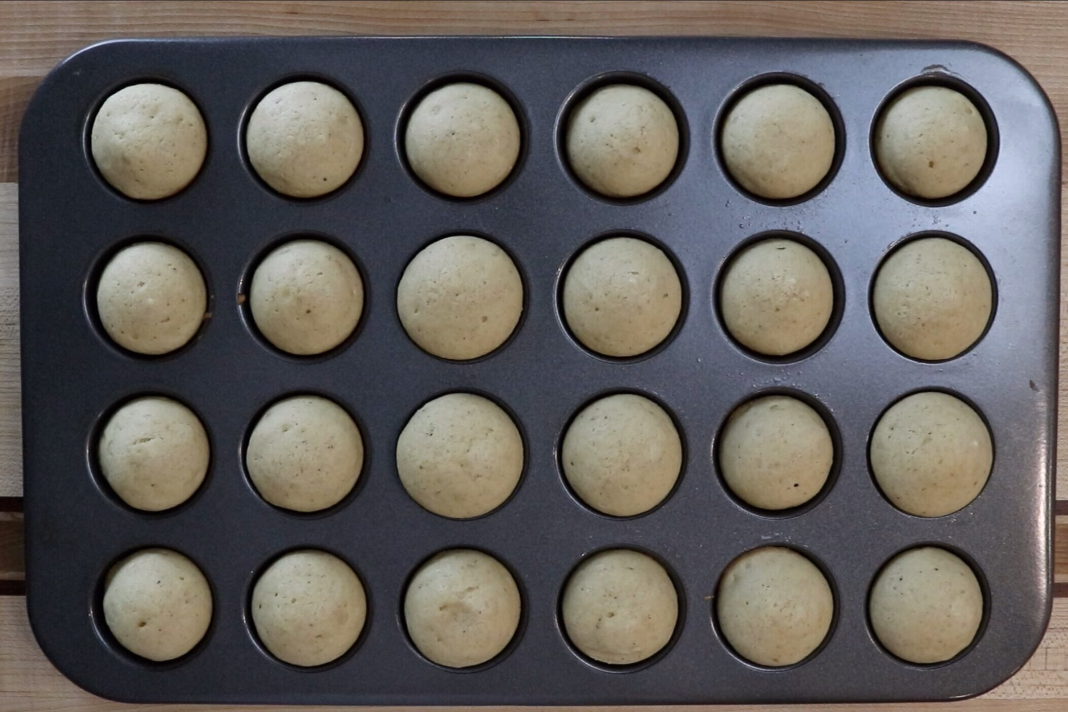 11. Remove from oven and let cool in pan for 5 minutes before releasing.  While the muffins are cooling melt the butter and prepare cinnamon/sugar. -