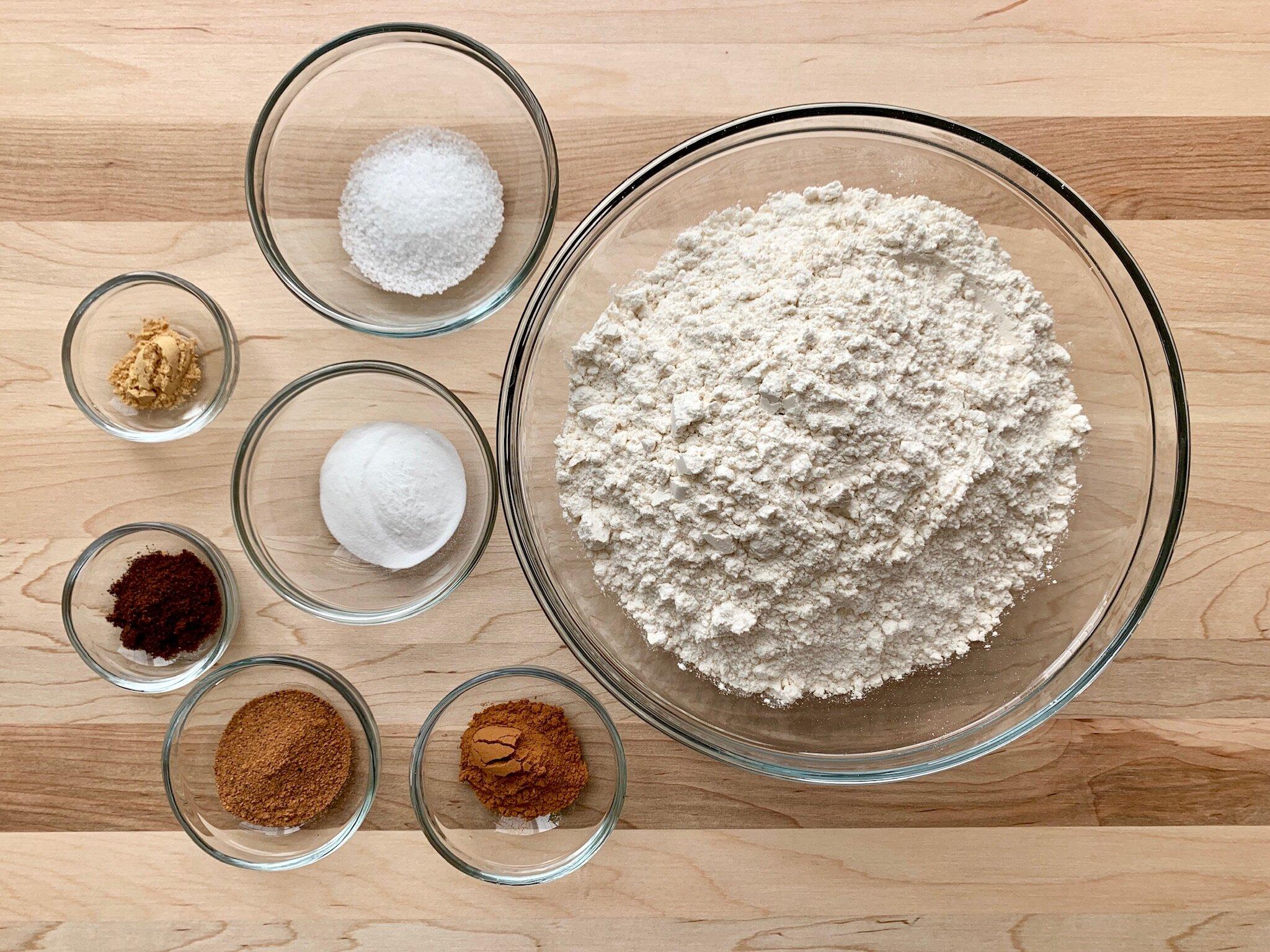 2. In a medium-sized bowl, whisk together flour, baking soda, salt, cinnamon, nutmeg, cloves, and ginger. -