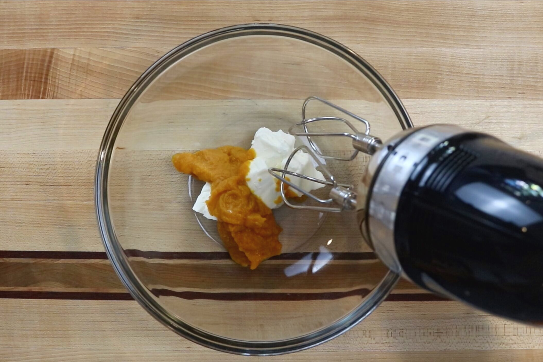 3. In a large bowl, beat together the pumpkin puree and cream cheese until smooth. -