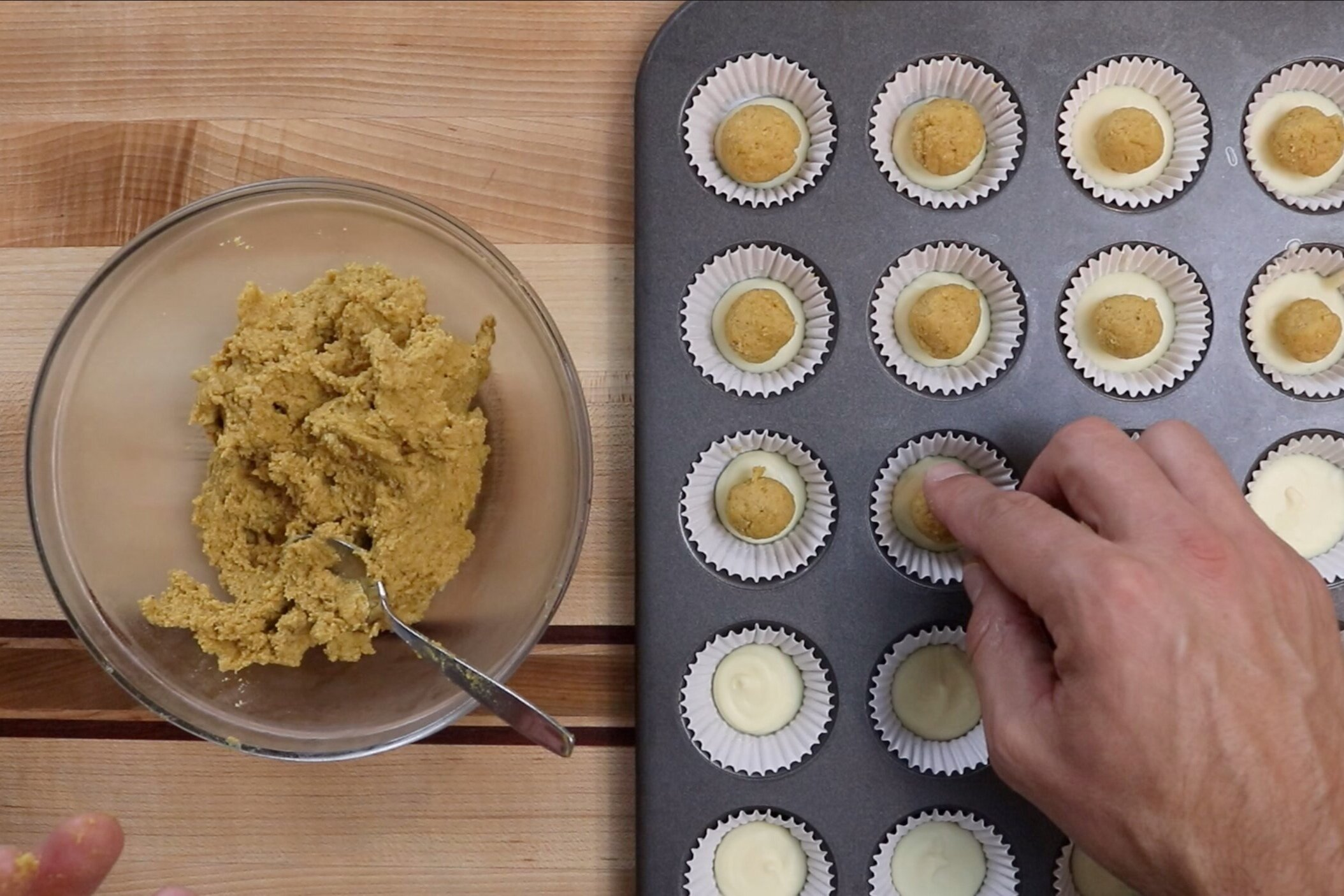 9. Roll a teaspoon of the pumpkin mixture between your hands making small balls.  Place the pumpkin balls in the middle of each cup on top of the hardened white chocolate. -