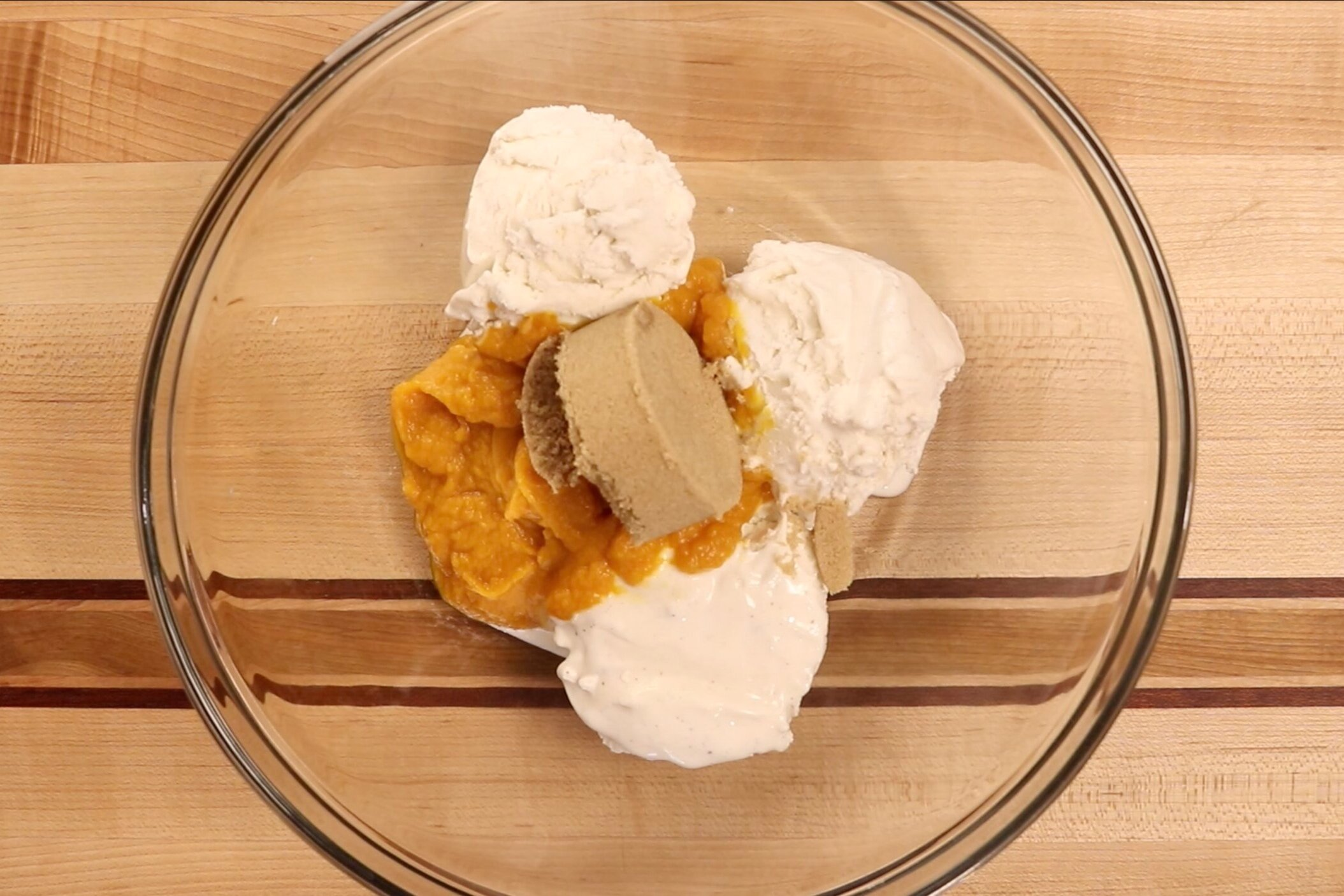 6. In a large bowl, add the ice cream, pumpkin and brown sugar. Beat until smooth and creamy. -