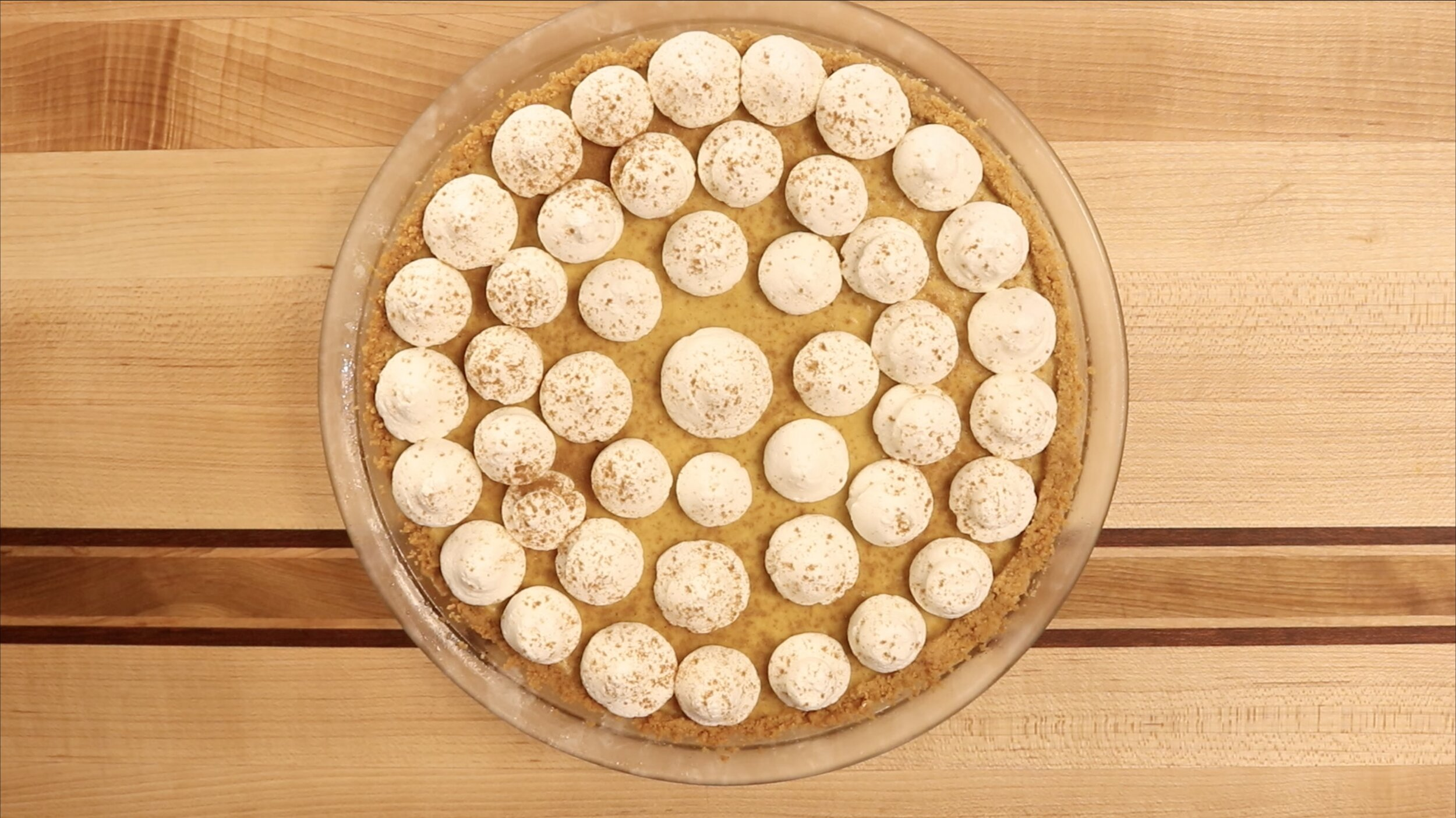 10.  Add the whipped cream topping and sprinkle cinnamon on top. Freeze for another 2 hours before serving. -