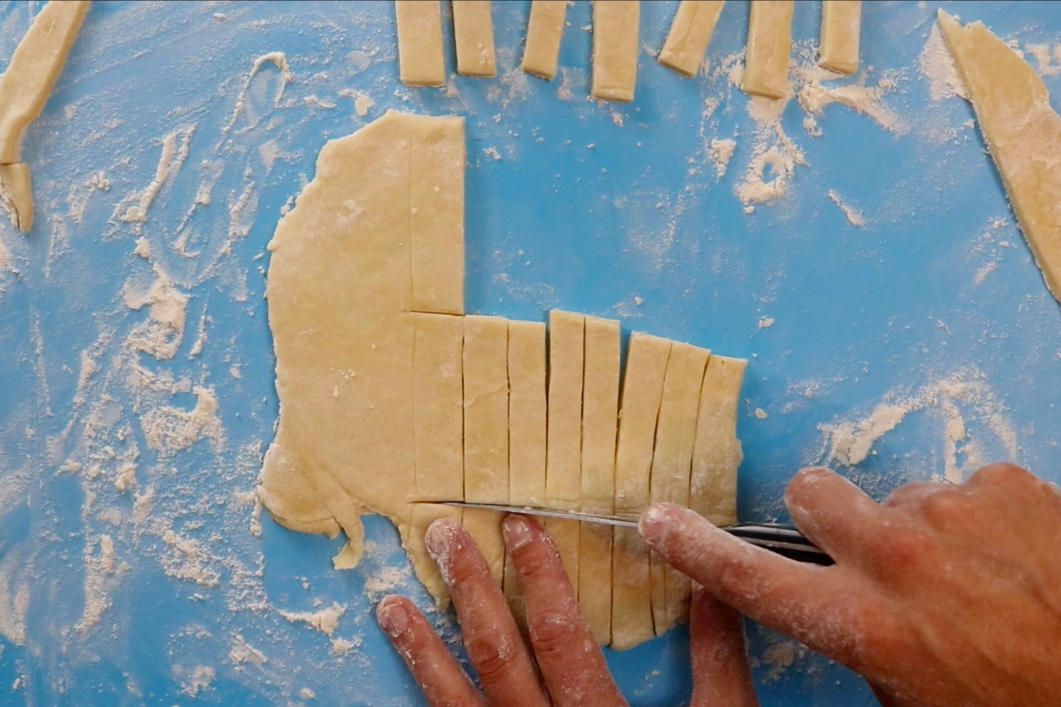 """4. Roll out second half of pie dough and cut into small 2"""" strips. -"""