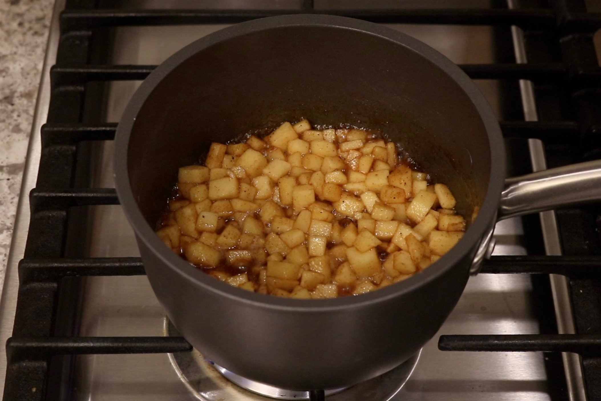 2. Heat over medium for 5-7 minutes stirring occasionally until apples begin to soften and mixture has a caramel consistency. Set aside. -