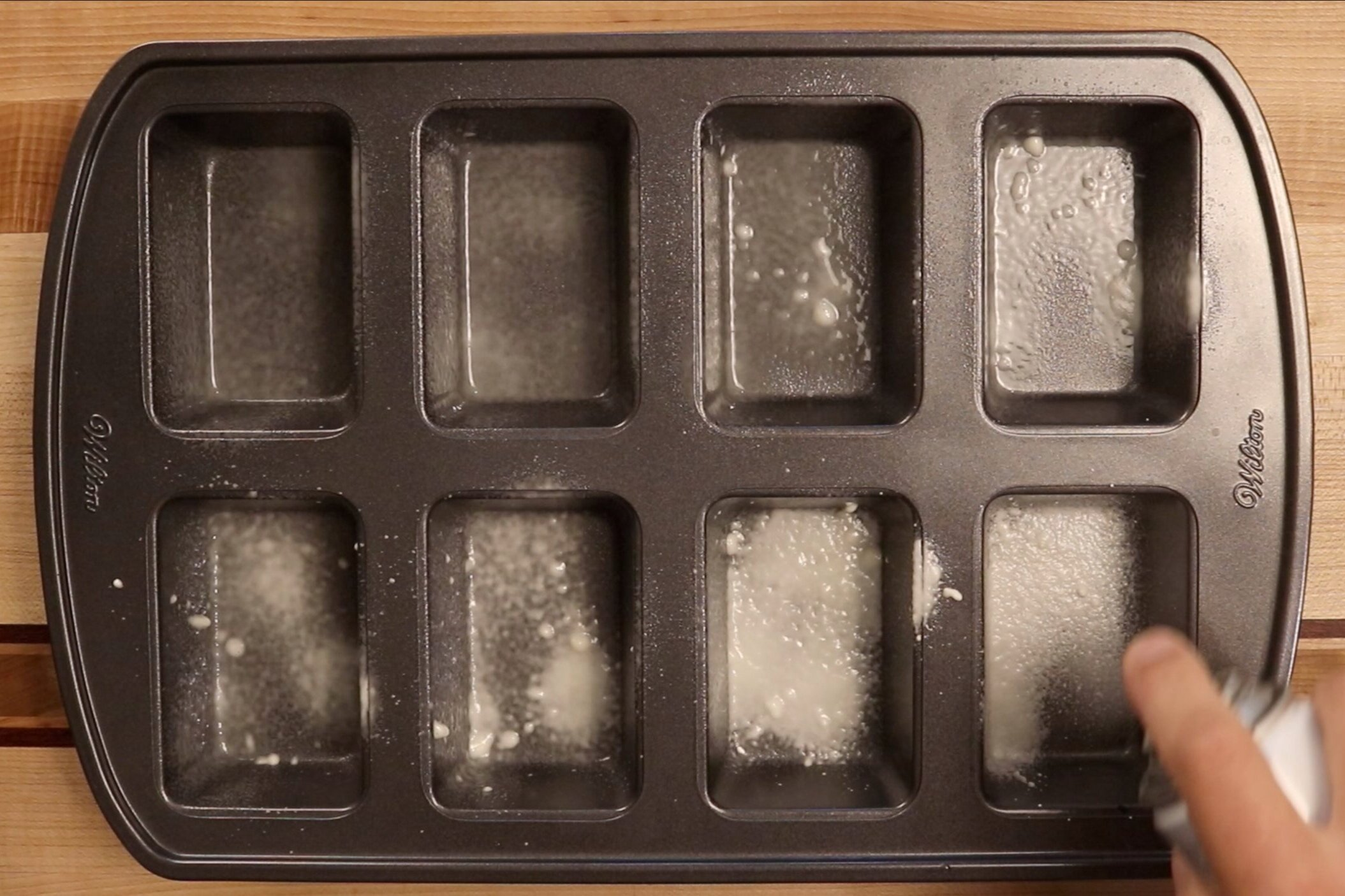 3. Pre-heat oven to 350 degrees and grease an 8 count mini-loaf pan. -