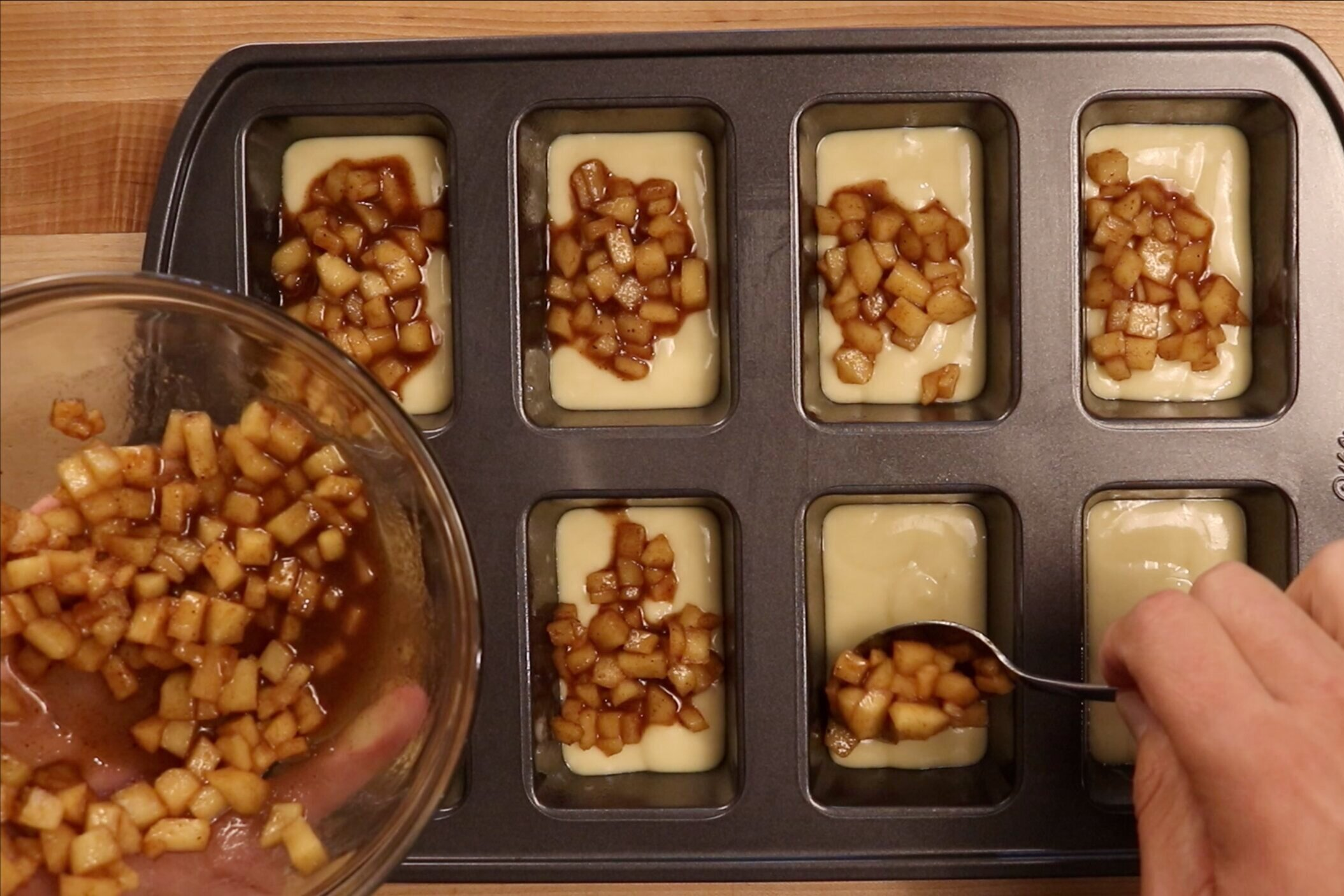 11. Add a teaspoon of the apple filling to each loaf. -