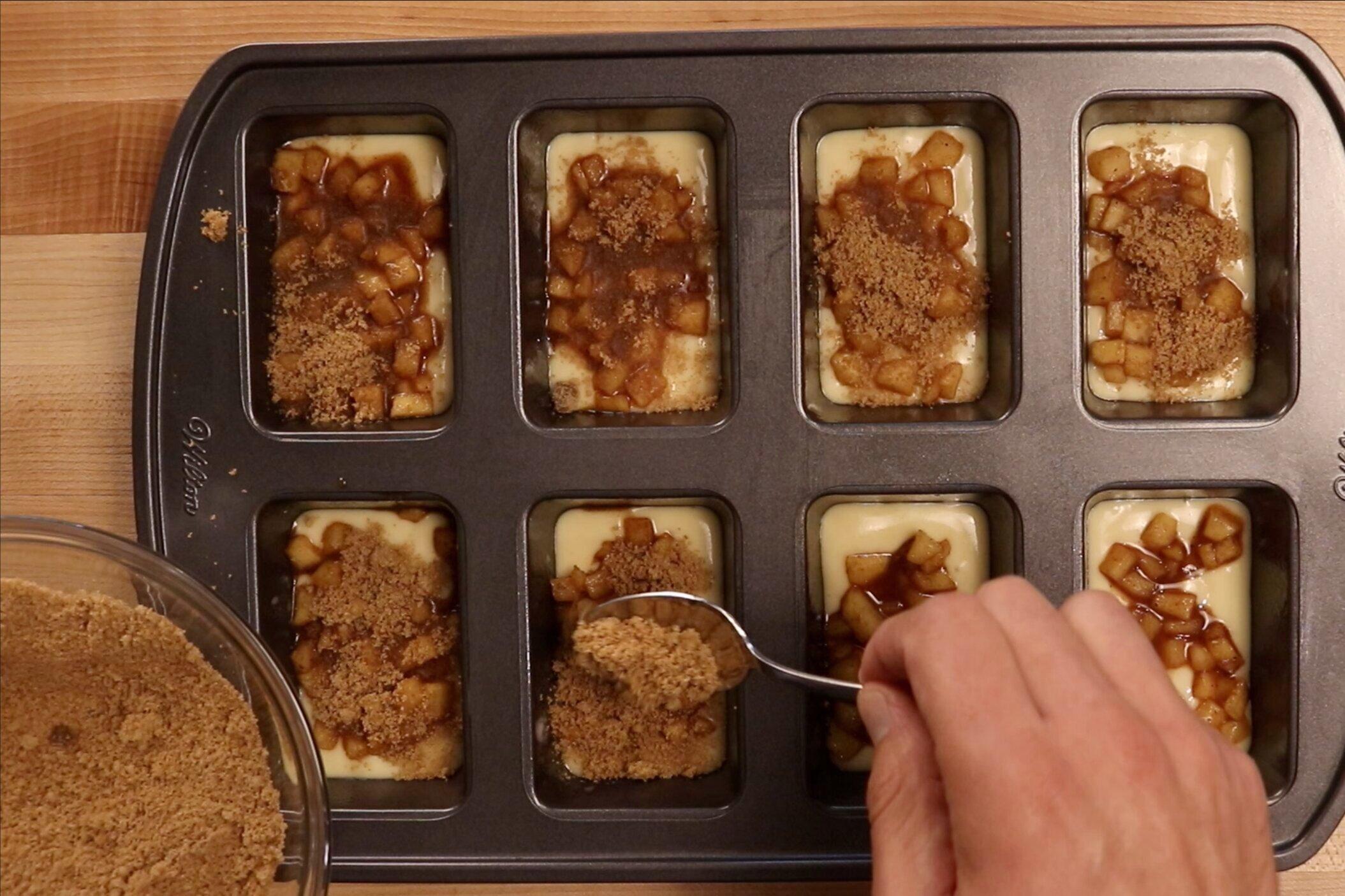 12. Add a teaspoon of the cinnamon-brown sugar mixture to each loaf. -