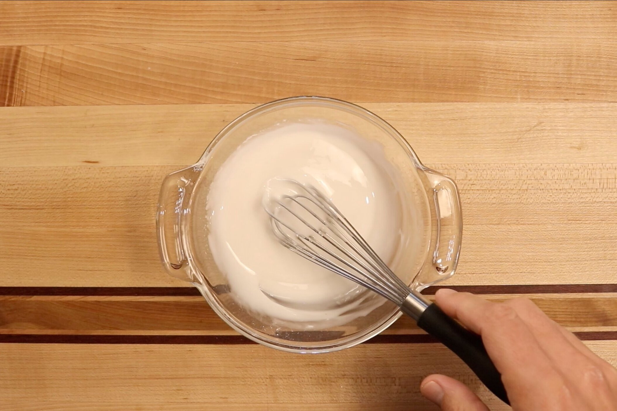 17. Whisk together until glaze reaches a honey-like consistency adding more water if necessary. -