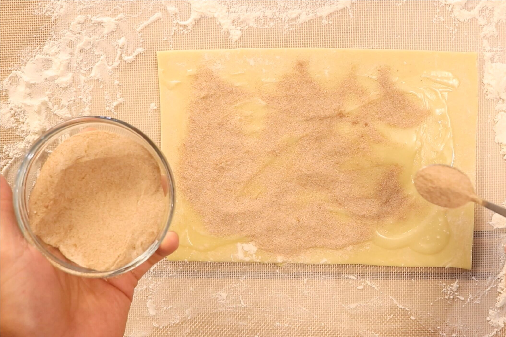 10. Mix the sugar and cinnamon together then evenly sprinkle over dough. -