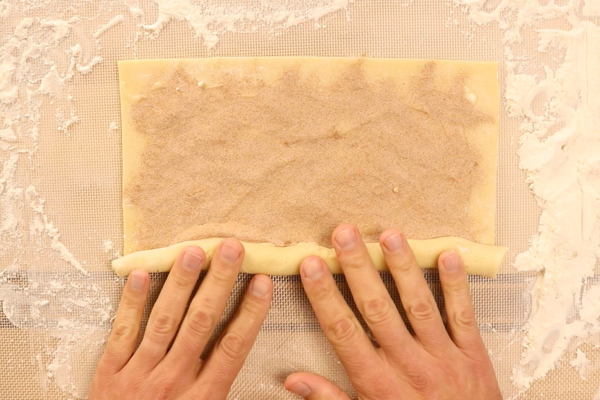 11. Carefully, tightly roll the dough starting with the long side. -