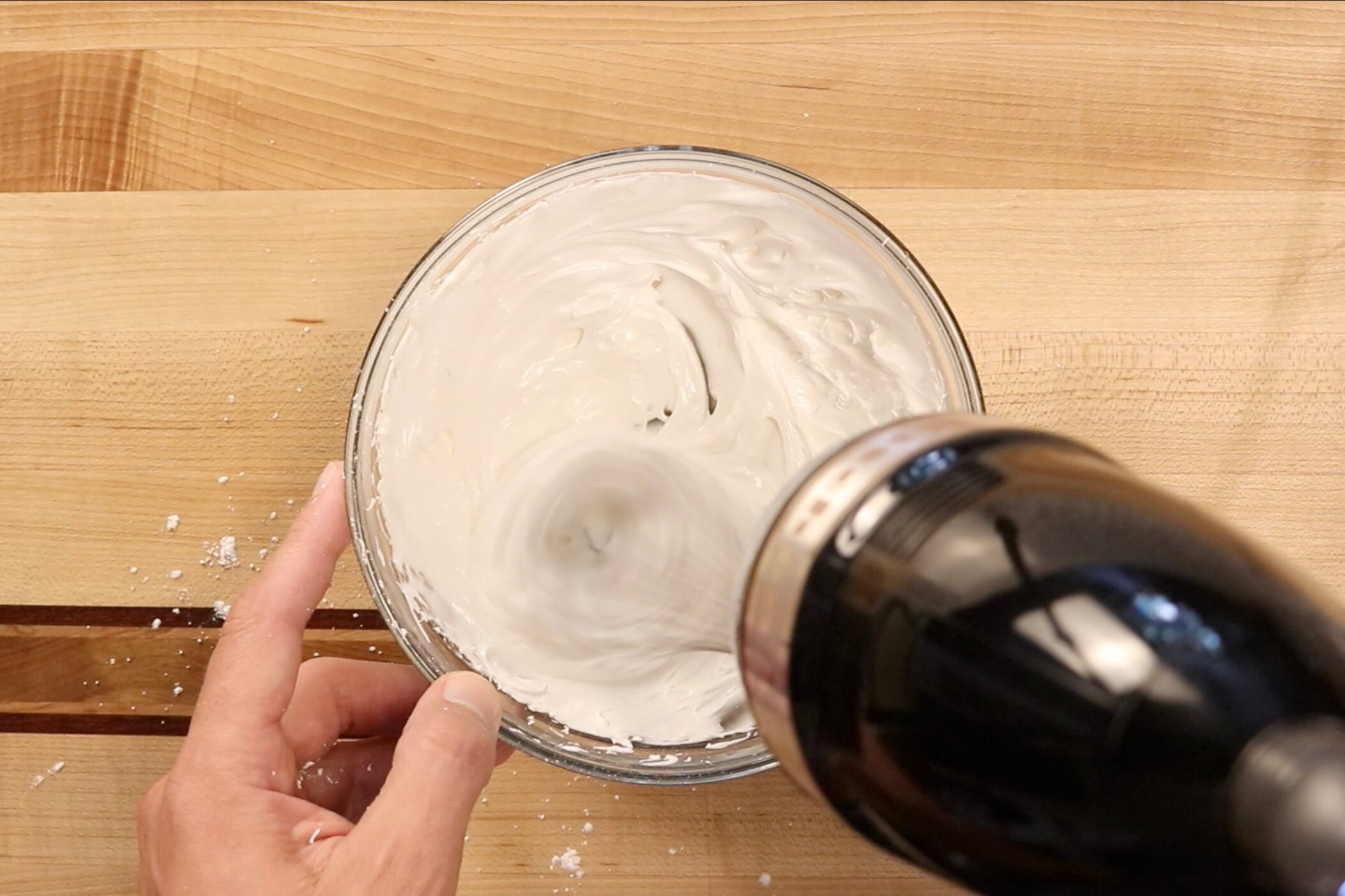 17. Add the vanilla and most of the water. Mix on low speed until incorporated. Then mix on medium high speed for 2-3 minutes until icing is thick and glossy. Add more water if needed. -