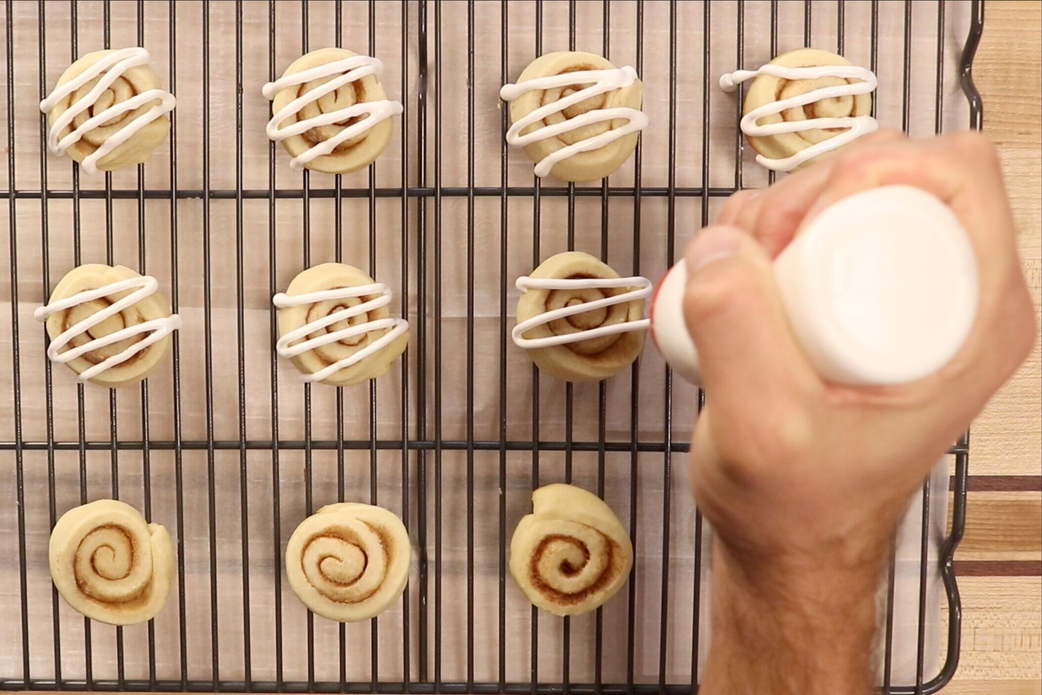18. Using a piping bag or a spoon, drizzle icing over cookies. Let harden for an hour before storing. -