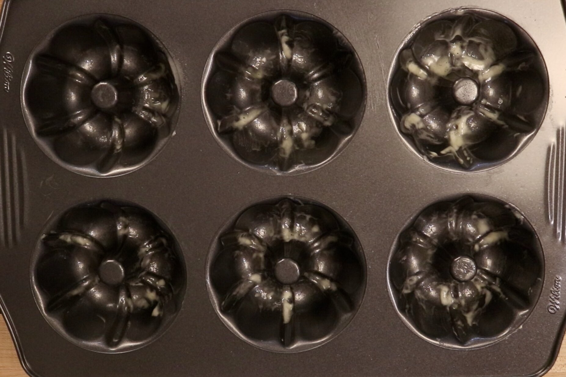 1. Pre-heat oven to 350 degrees and grease two 6-count mini-Bundt pans with baking spray. -