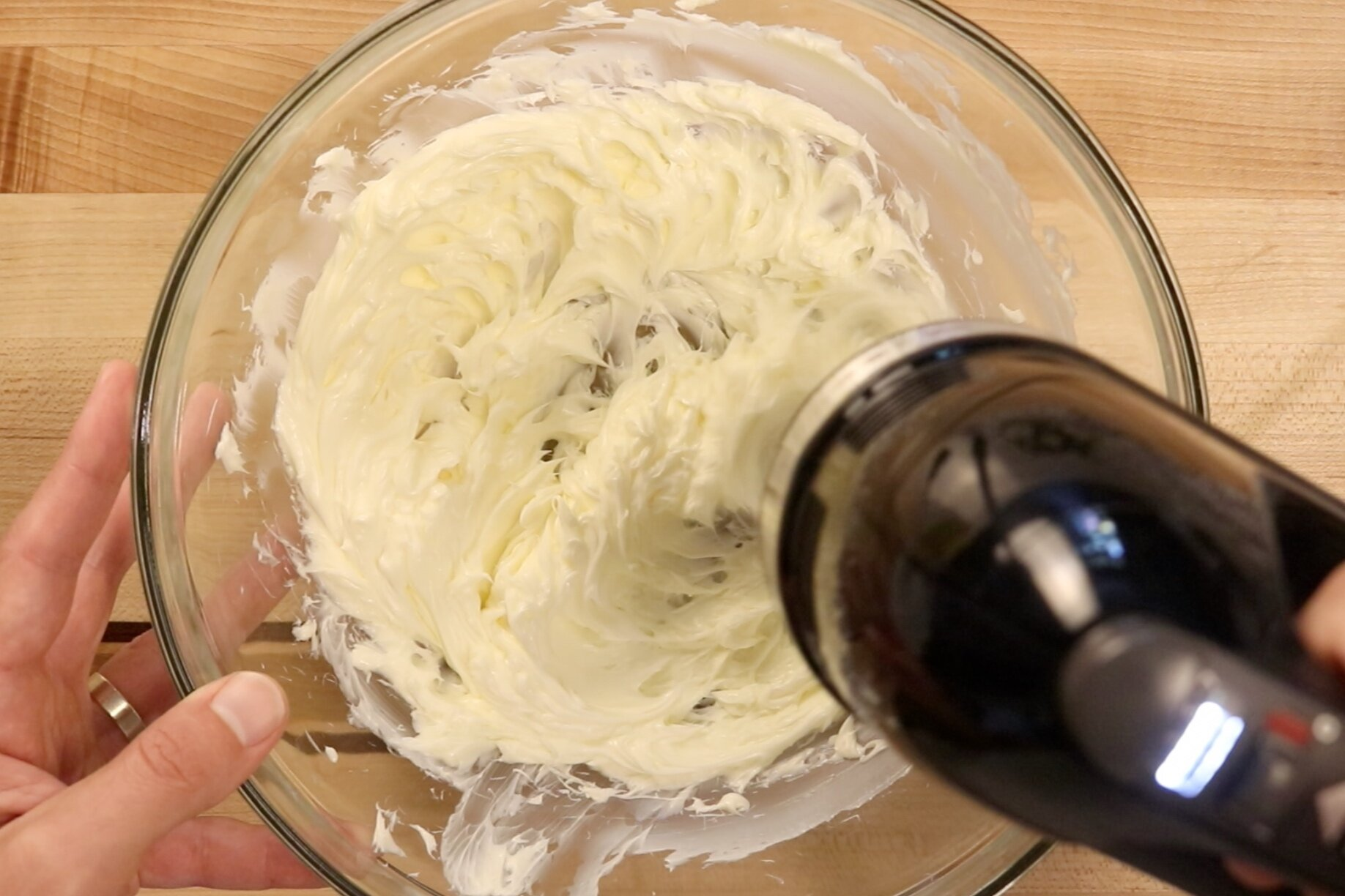 7. Gradually increase mixing speed to high and beat for 1-2 minutes and icing is light and fluffy. -