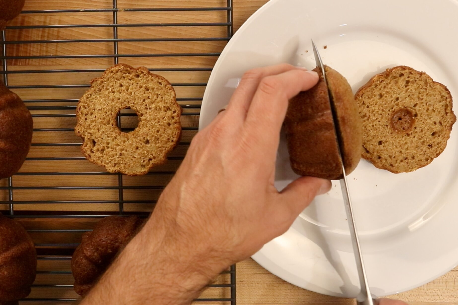 1. Level the cakes with a serrated knife. Remove the bottom of each cake so they all are the same height. -