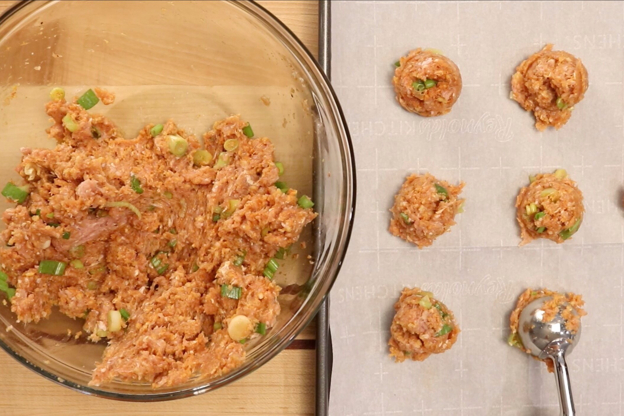 3. Make small balls of the turkey mixture using a spoon or a small scoop. Place on the baking sheet. You should have around 24 small meatballs. -