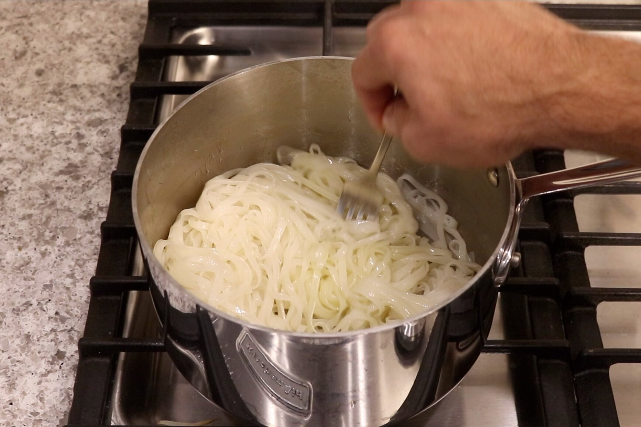 8. Drain and return to pot with 1 teaspoon of coconut oil. Toss together and set aside. -