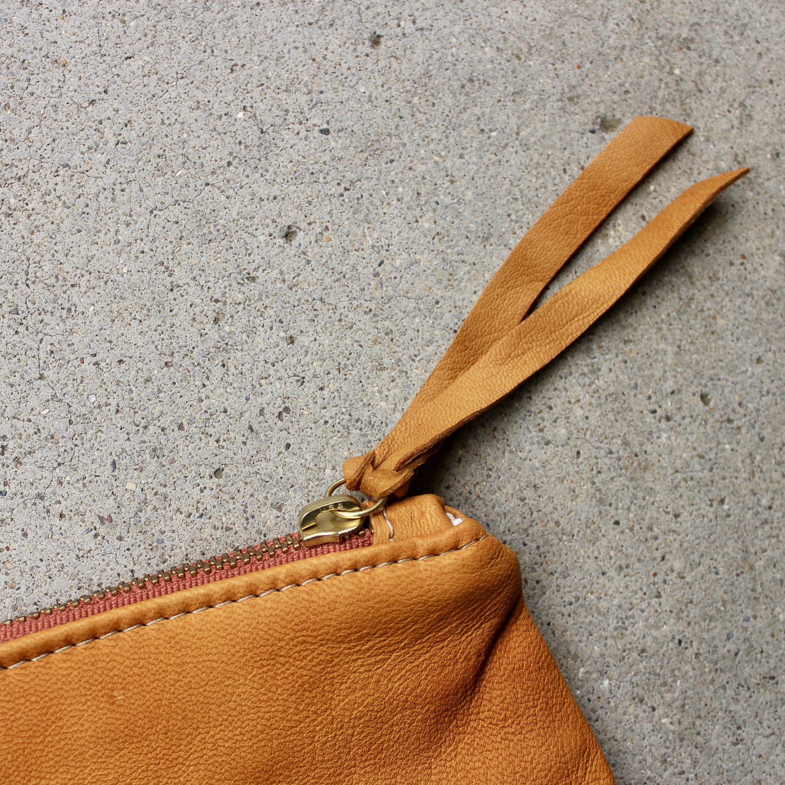 tan leather pouch close up.jpg