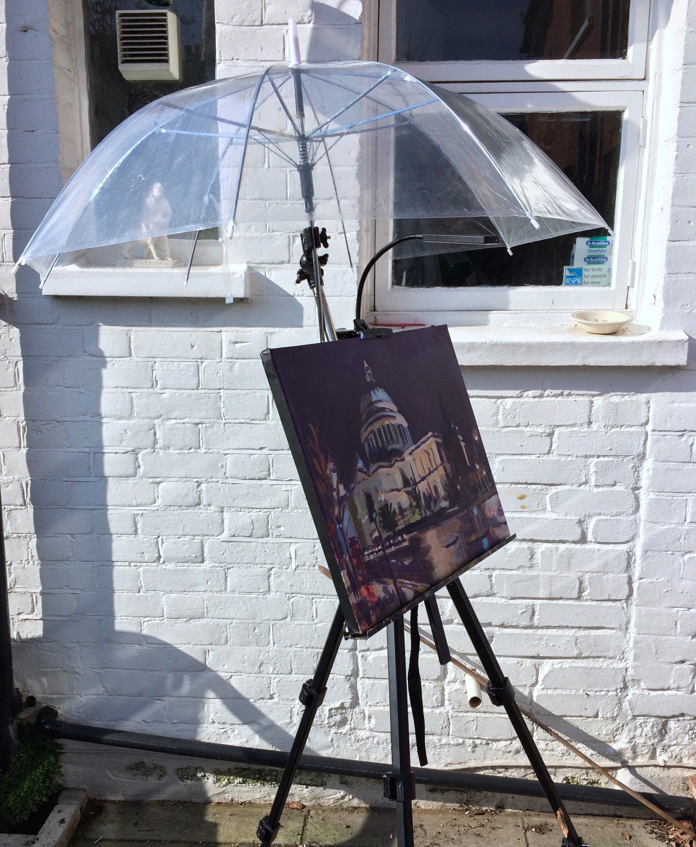 Umbrella with improvised clamp arm fitted to my portable field easel. The equipment is lightweight which makes it perfect for travelling on public transport in London... but watch out for strong winds outdoors