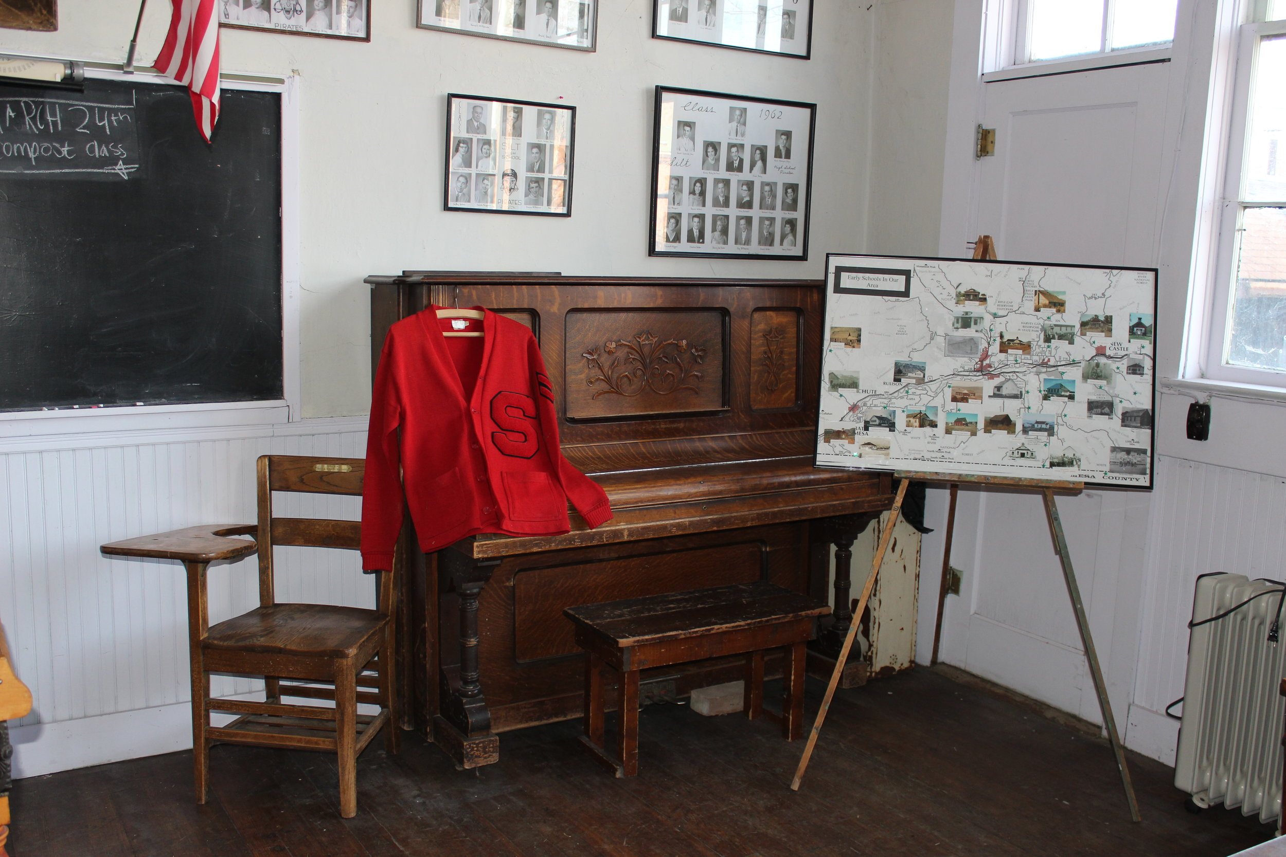 A letter jacket from Silt High School hangs on the piano in the Austin School.
