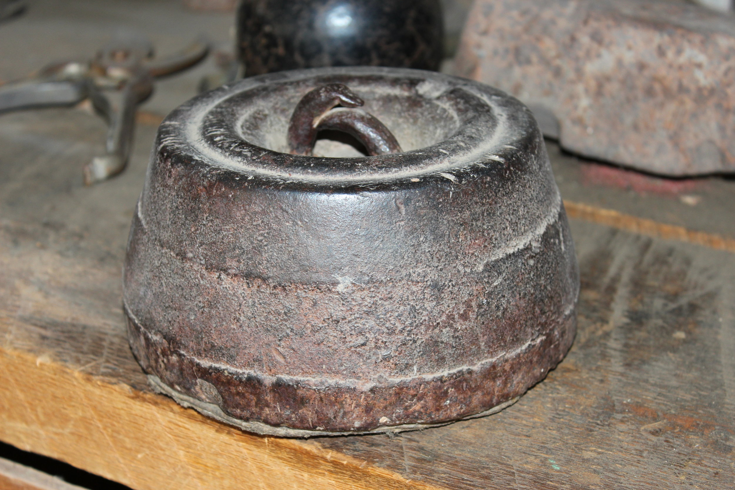 This heavy weight was used to tie a horse in place.