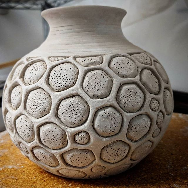 Carving. Lots of carving. So calming and stressful at the same time. In the world of clay there are so many different ways and stages for pieces to break. Praying to the kiln gods to keep this large honeycomb vase alive! #jneceramics #pottery #potter #instapottery #instaceramics #greenware #honeycomb #handcarved #wheelthrown #diamondcoretools #reliefcarving