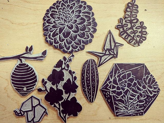 More stamps. A few of these will be reduction prints, so more will be carved away as I layer colors 💚 #dahlia #succulent #cactus #terrarium #origami #crane #elephant #orchids #linoleumblock #printing #printmaking #handcarved #jneprints