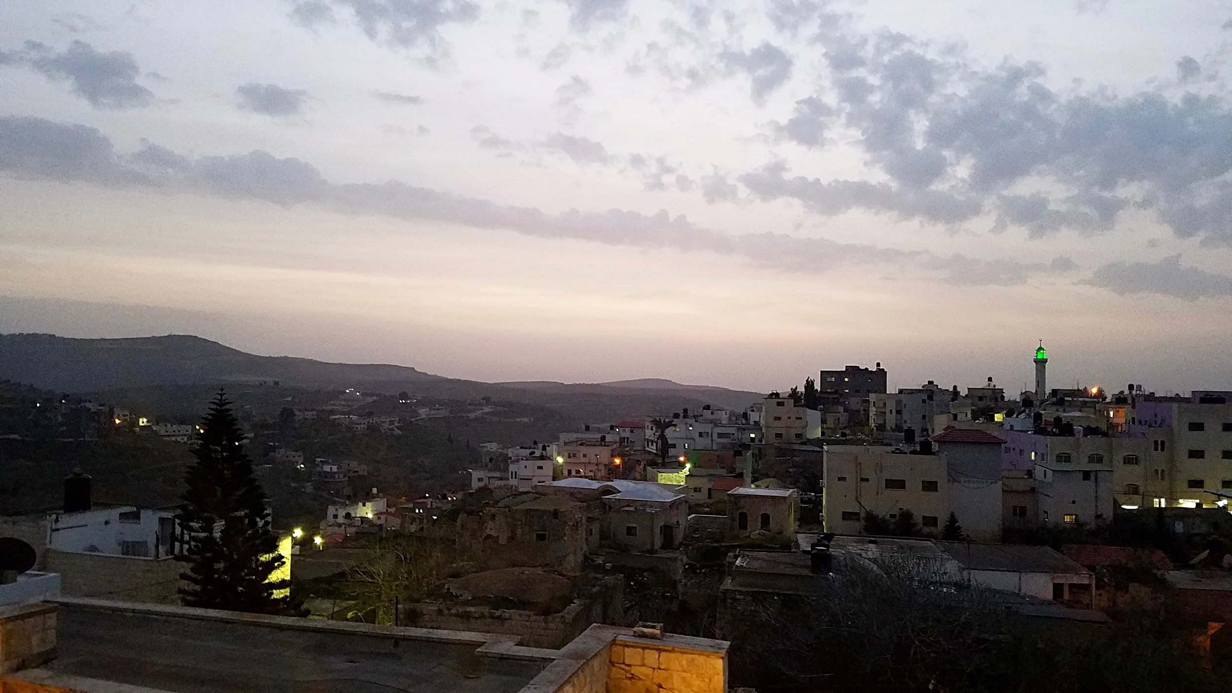 The village of Arraba at sunset from the rooftop of an Ottoman-era mansion turned community centre