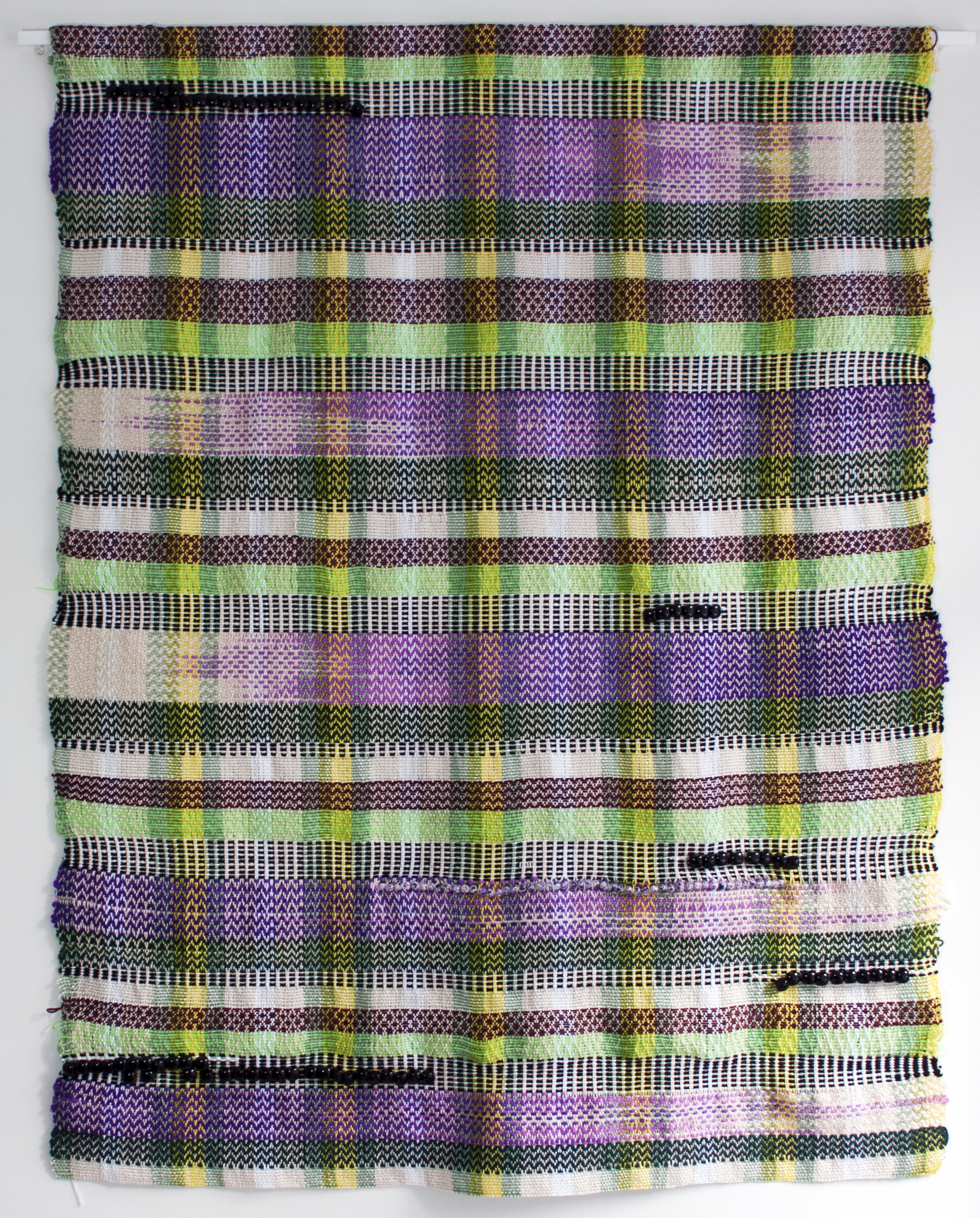 Handwoven tapestry- Mixed yarns, plastic, glass, and beads. 47 x 36 in 2017